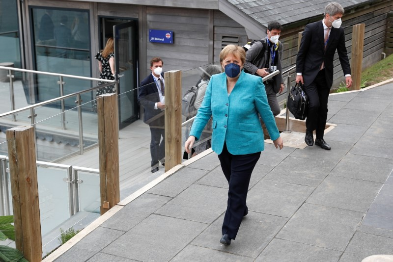 German Chancellor Angela Merkel walks after a bilateral meeting with Britain's Prime Minister Boris Johnson during the G7 summit in Carbis Bay, Cornwall, Britain, June 12, 2021. REUTERS/Peter Nicholls/Pool