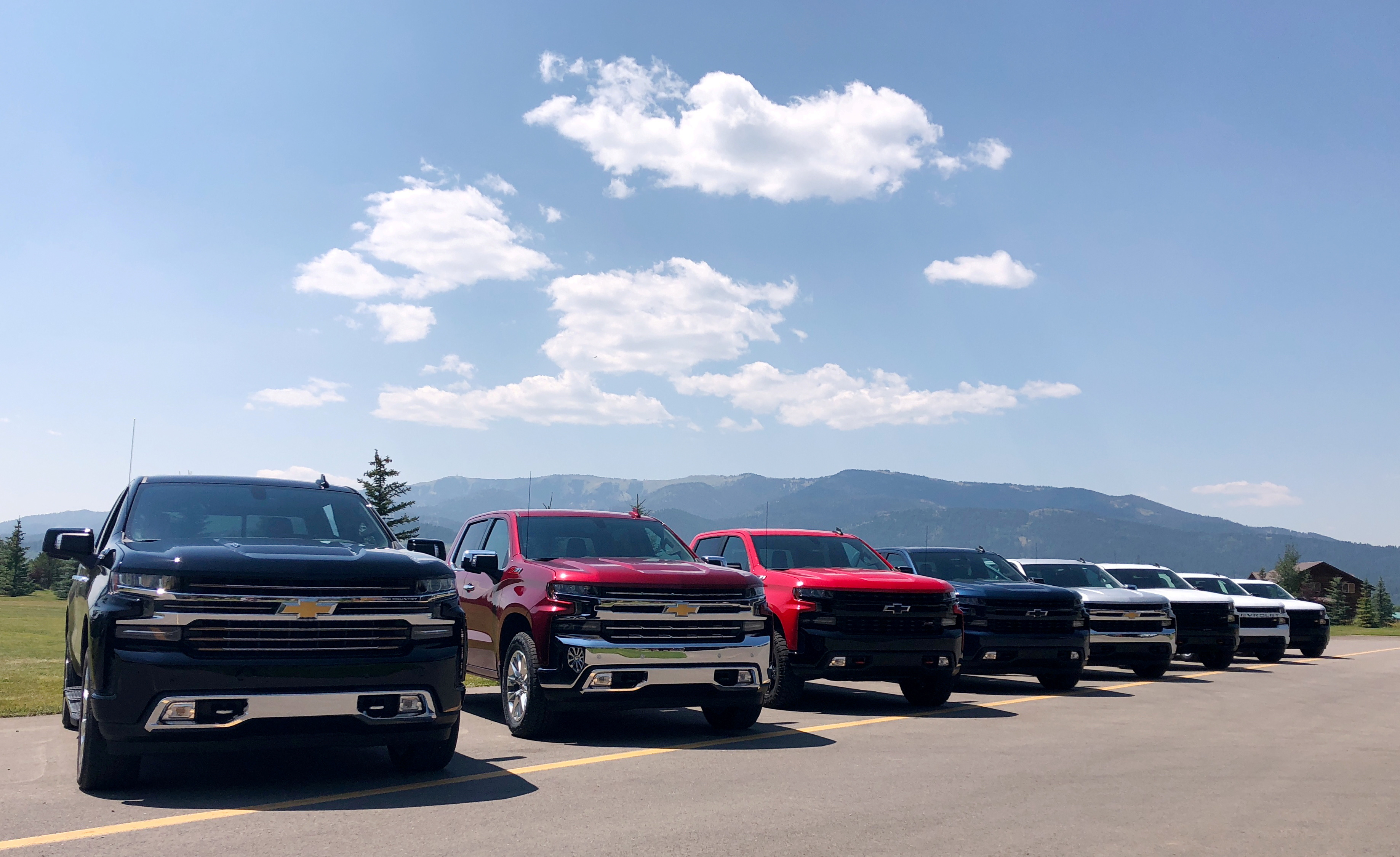 Eight versions of General Motors Co's Chevrolet Silverado pickups are pictured lined up at an event near Alpine, Idaho, U.S. August 7, 2018.  REUTERS/Joseph White/File Photo