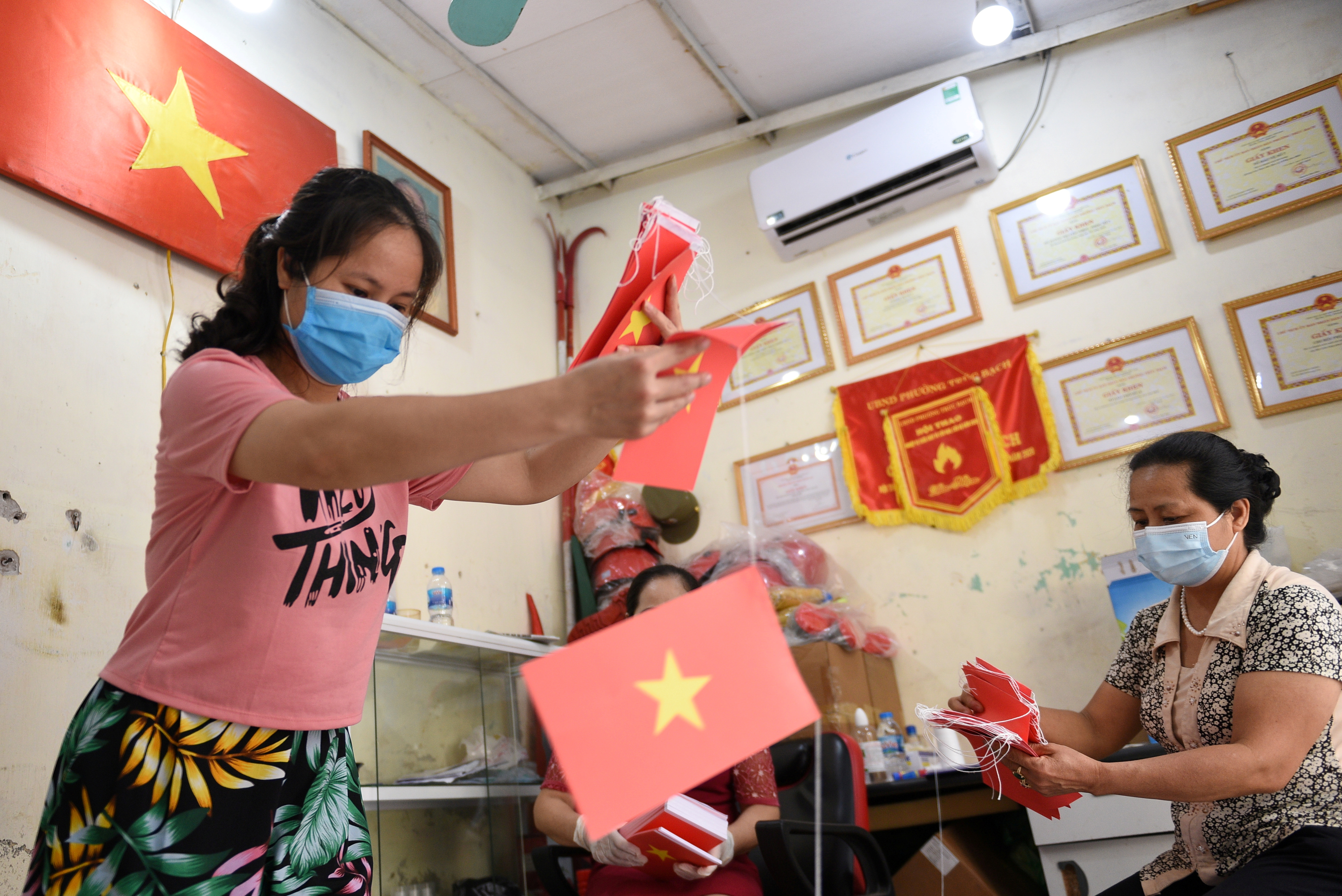Local officials prepare a polling station ahead of upcoming elections in Hanoi, Vietnam, May 19, 2021. REUTERS/Thanh Hue/File Photo