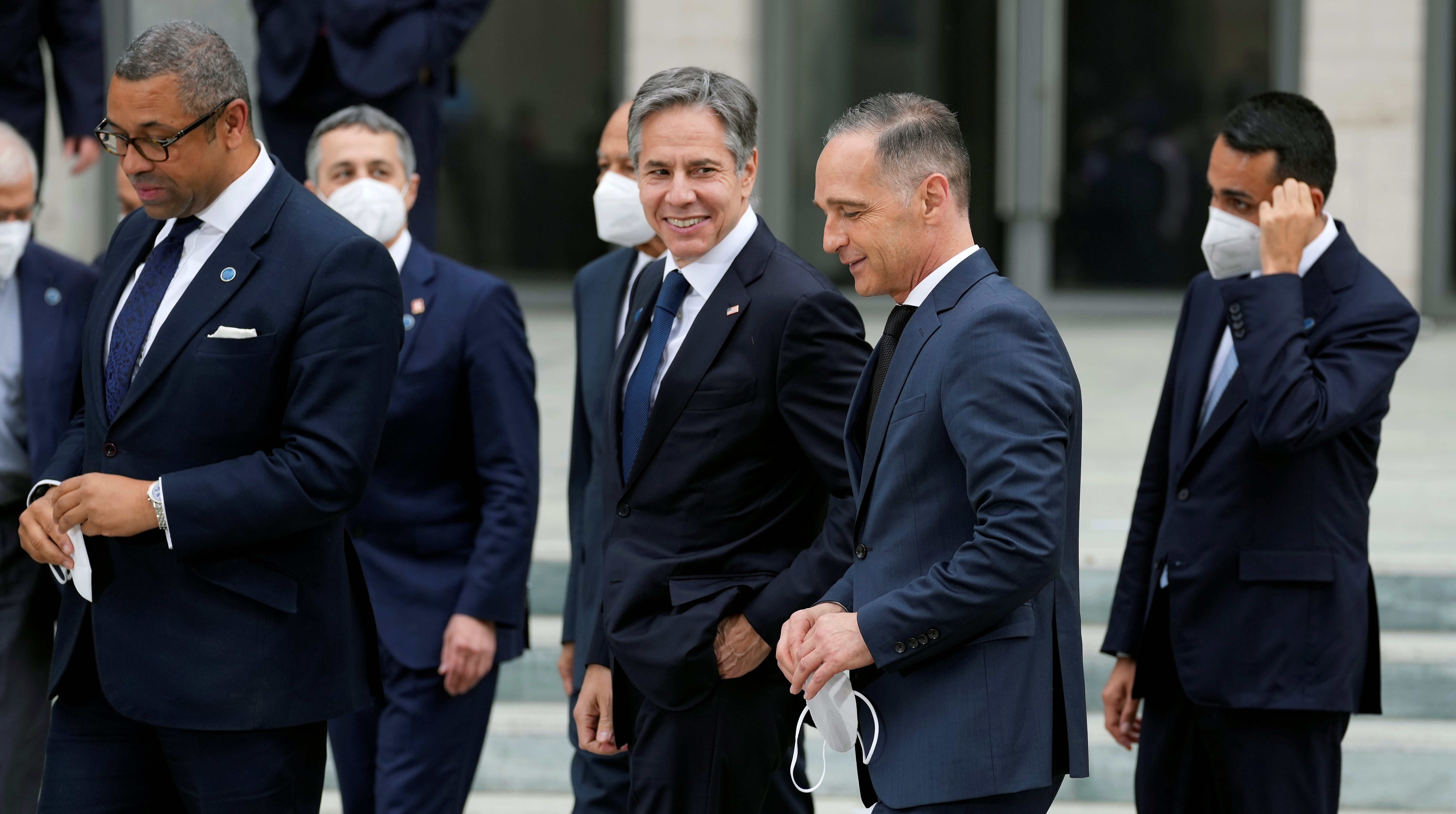 German Foreign Minister Heiko Maas and U.S. Secretary of State Antony Blinken talk after posing for a group photo during the 'Second Berlin Conference on Libya' at the foreign office in Berlin, Germany, June 23, 2021. Michael Sohn/Pool via REUTERS