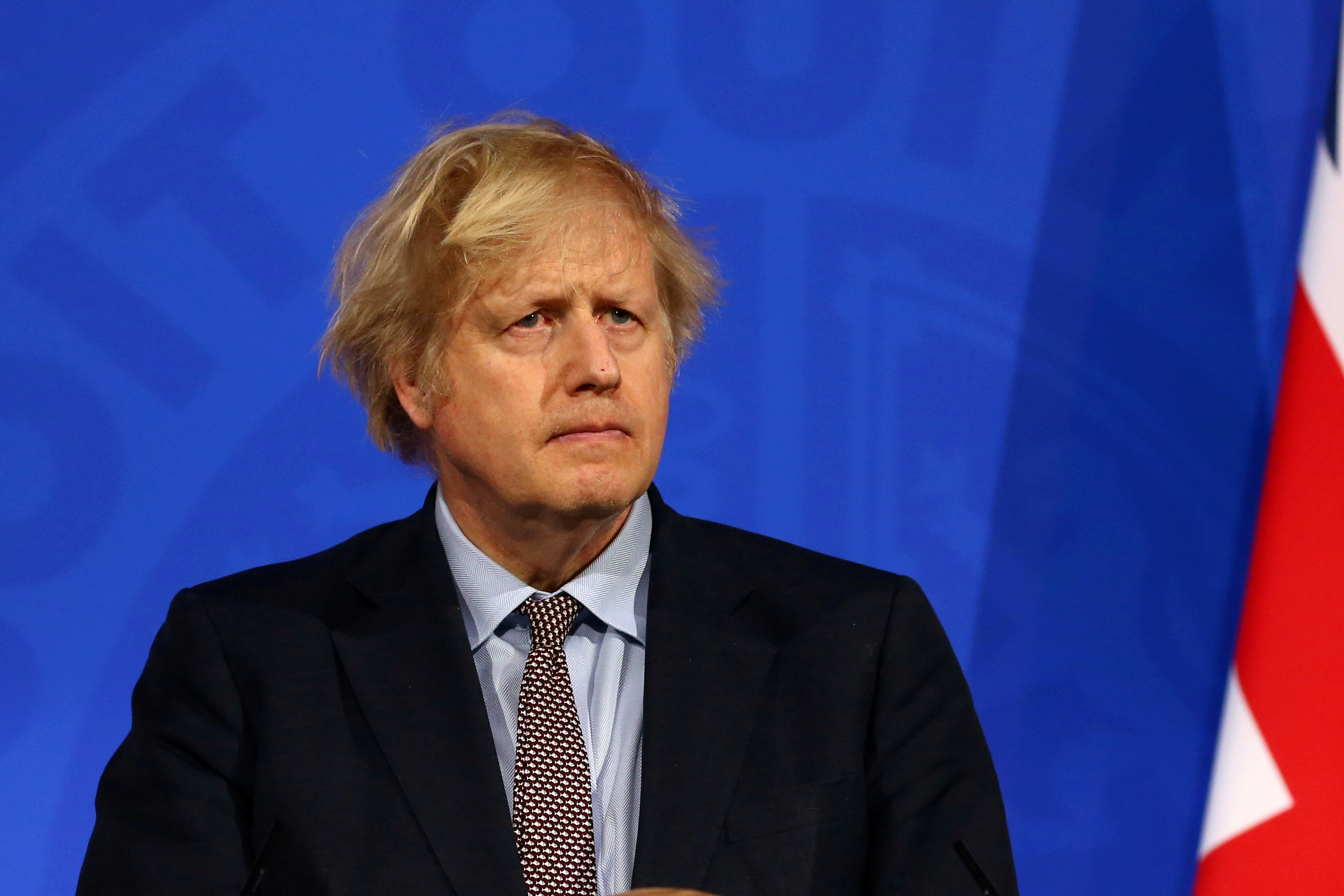 Britain's Prime Minister Boris Johnson holds a news conference on the coronavirus disease (COVID-19) pandemic, in London, Britain March 29, 2021. Hollie Adams/Pool via REUTERS/File Photo