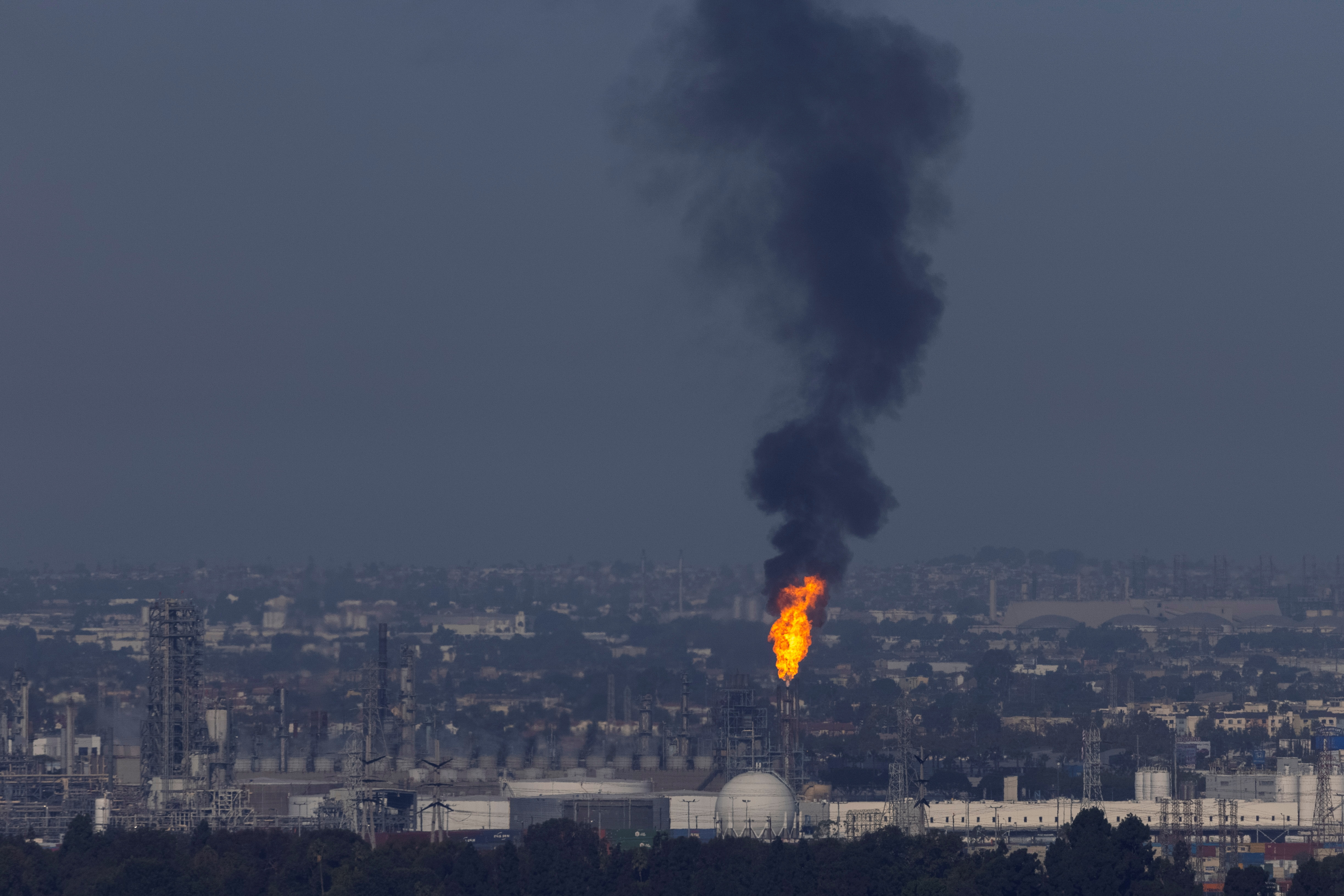 An oil refinery conducts a flaring operation in Carson, California, U.S., September 22, 2021. REUTERS/Mike Blake