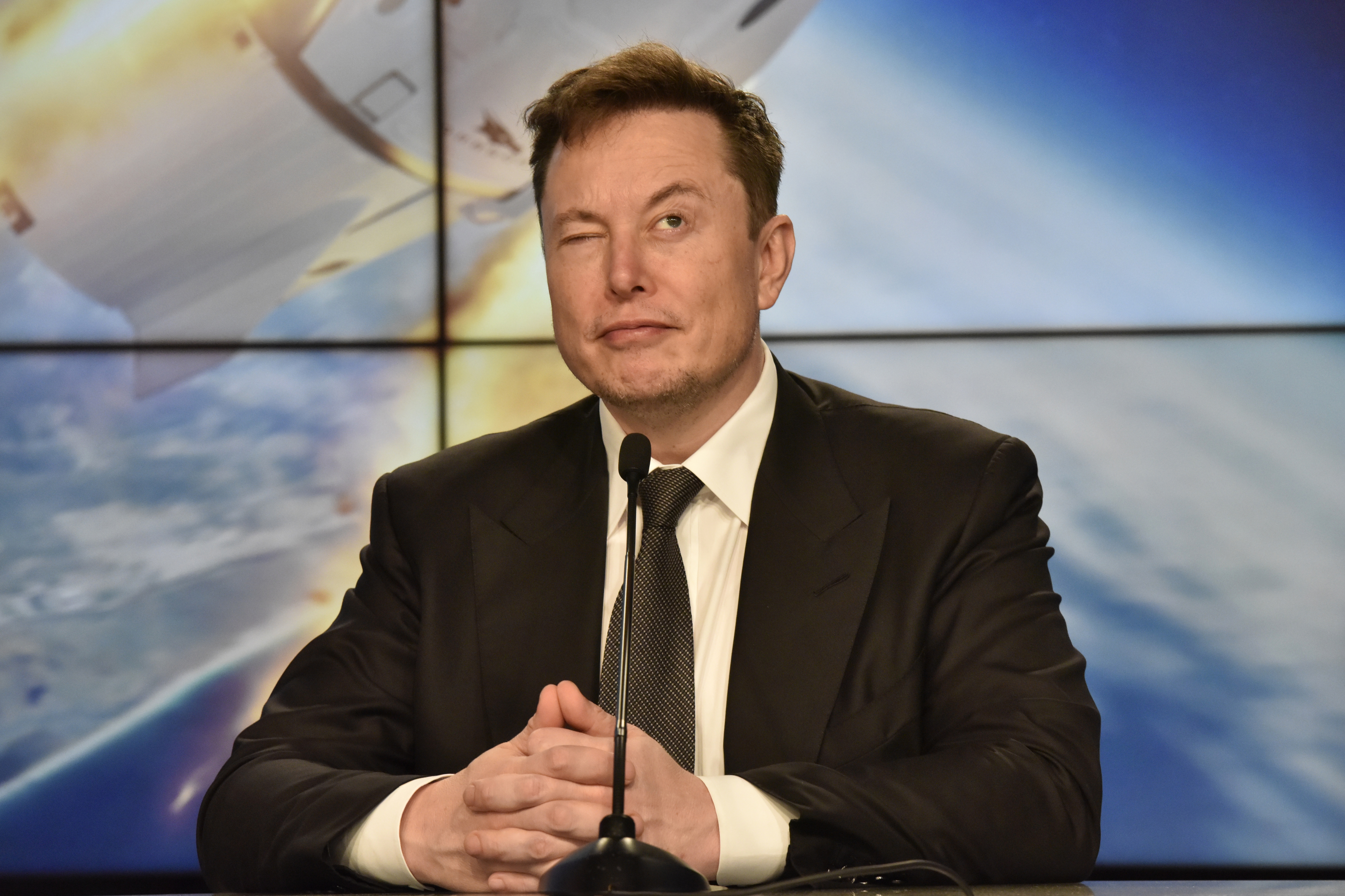 SpaceX founder and chief engineer Elon Musk reacts at a post-launch news conference to discuss the  SpaceX Crew Dragon astronaut capsule in-flight abort test at the Kennedy Space Center in Cape Canaveral, Florida, U.S. January 19, 2020. REUTERS/Steve Nesius - HP1EG1J1DBR10