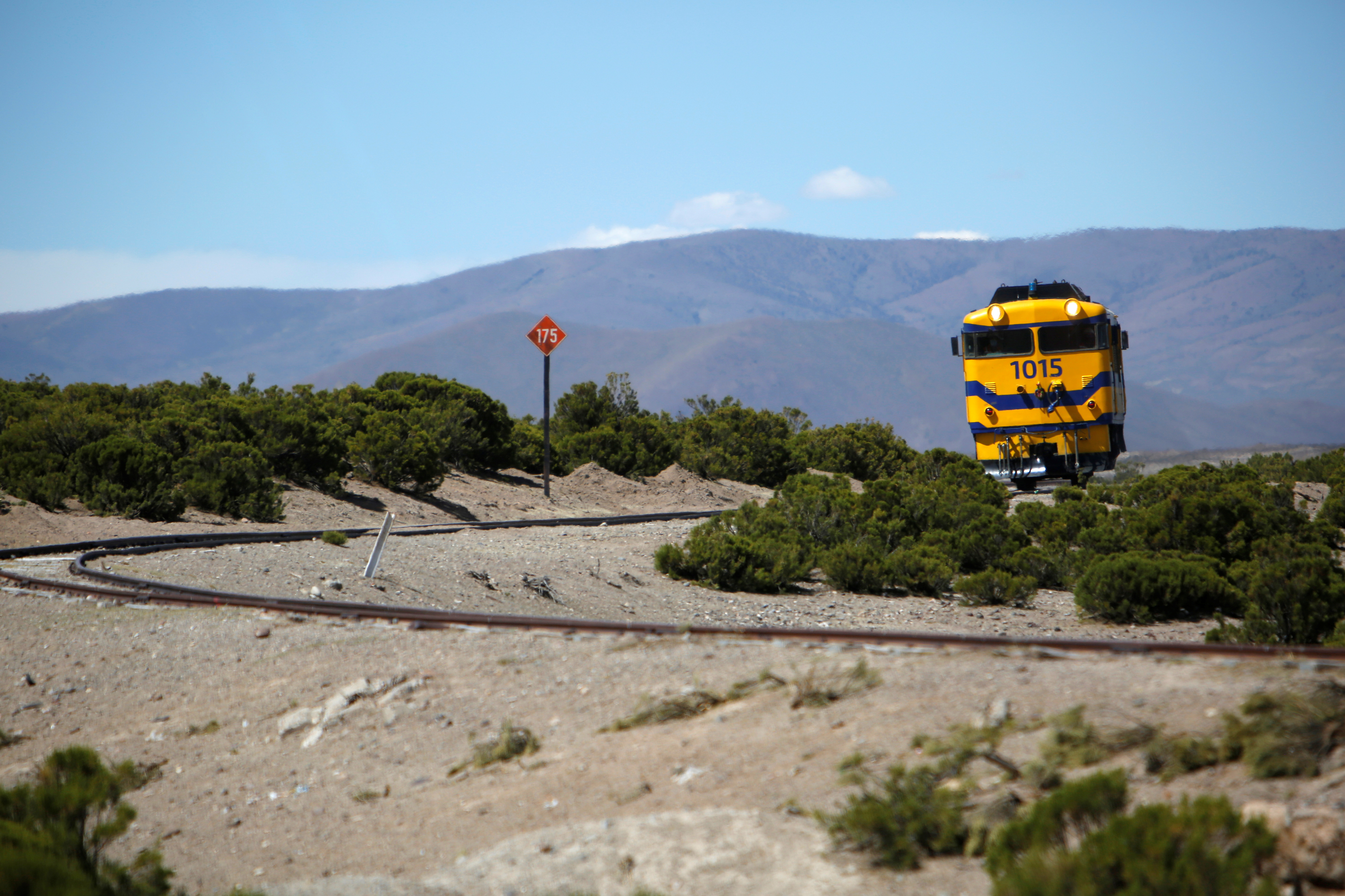 A locomotive of Bolivia's Andean Railway Company moves to cross the border between Bolivia and Chile to pick up iron coil, in Charana, Bolivia May 7, 2021. Picture taken May 7, 2021. REUTERS/Manuel Claure