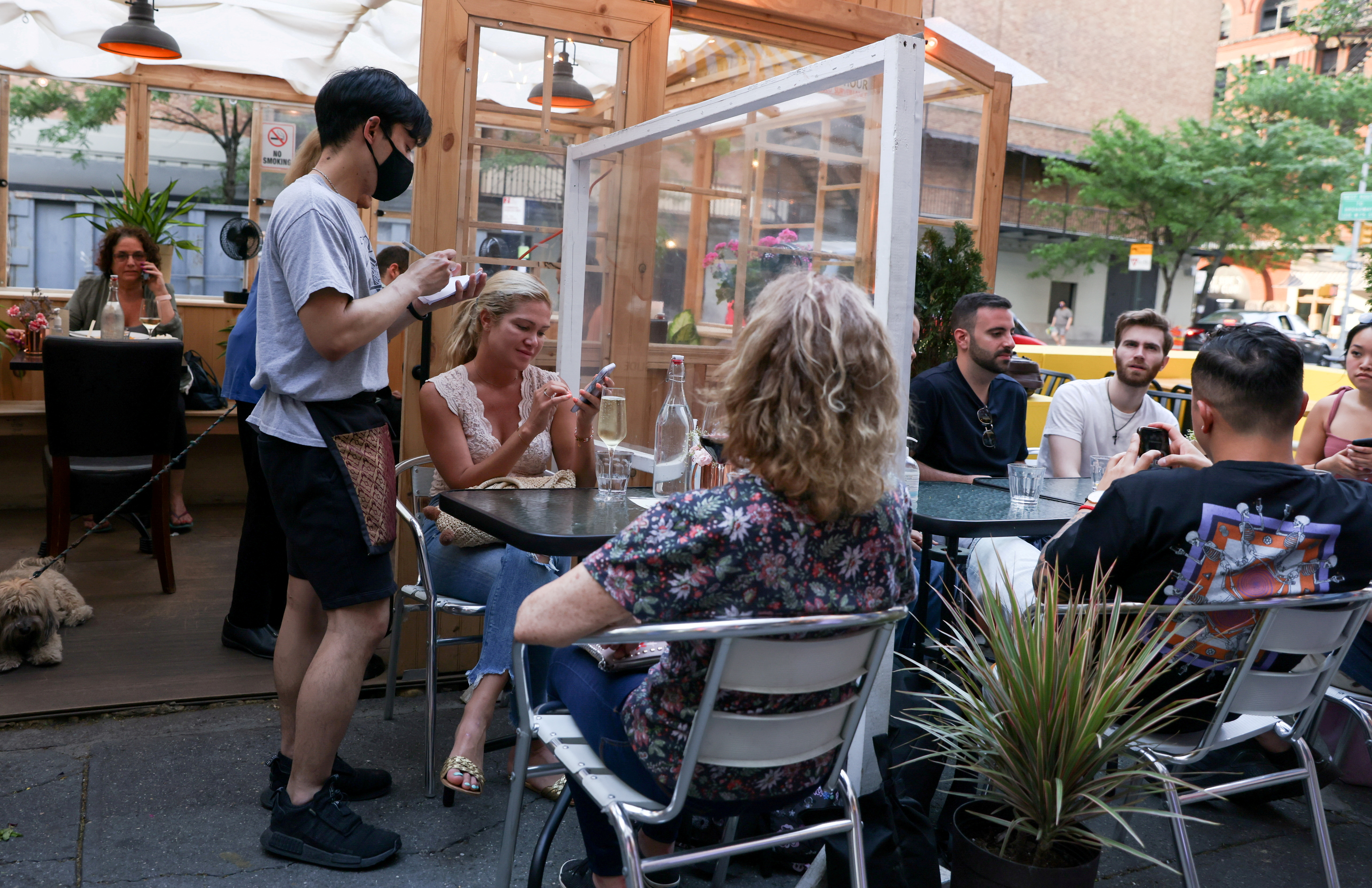 Guests enjoy outdoor dining in the Manhattan borough of New York City, U.S., May 23, 2021. REUTERS/Caitlin Ochs