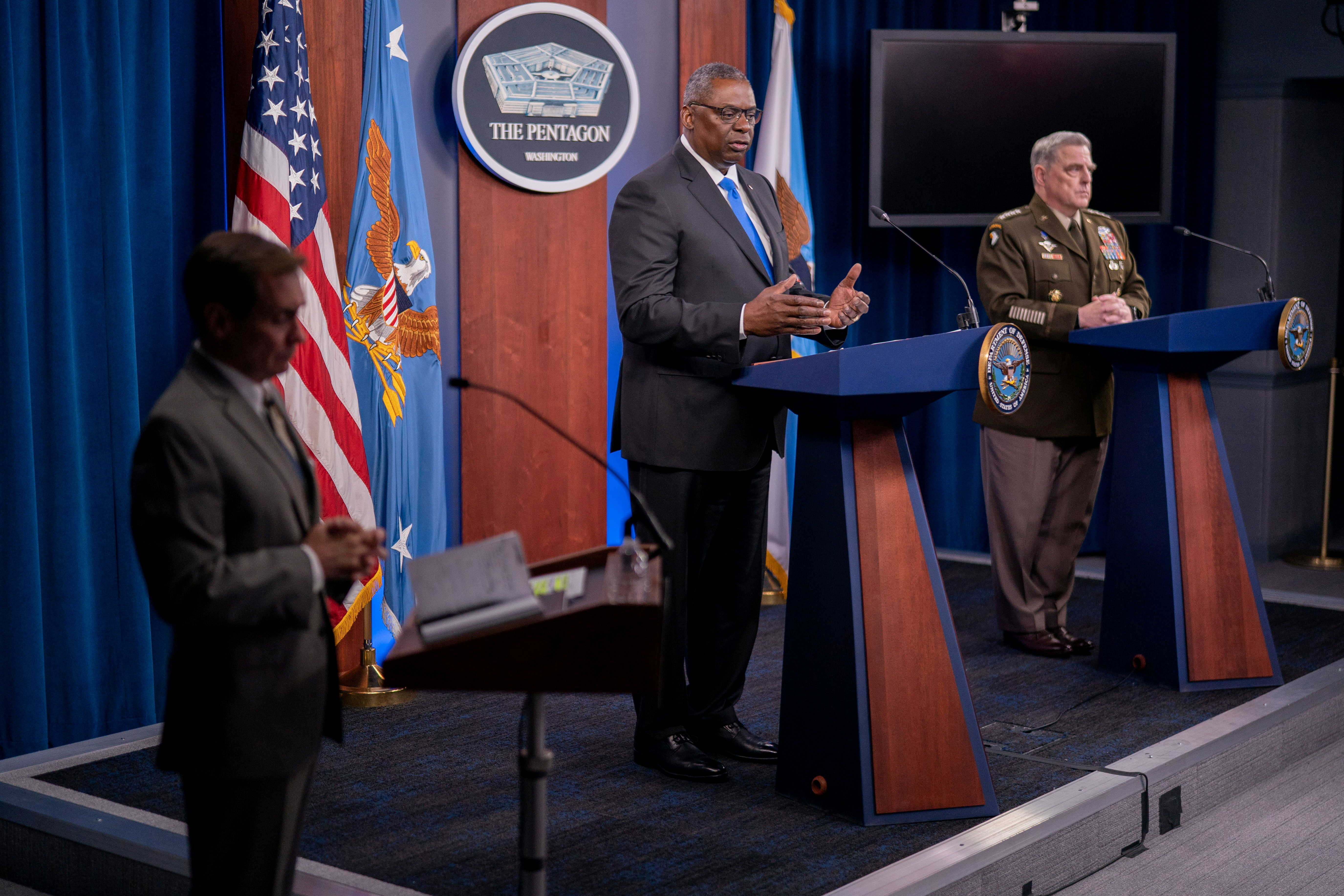 U.S. Defense Secretary Lloyd Austin, center, and Chairman of the Joint Chiefs of Staff General Mark Milley, right, brief reporters at the Pentagon as the U.S. military nears the formal end of its mission in Afghanistan in Arlington, Virginia, U.S. July 21, 2021. REUTERS/Ken Cedeno/File Photo