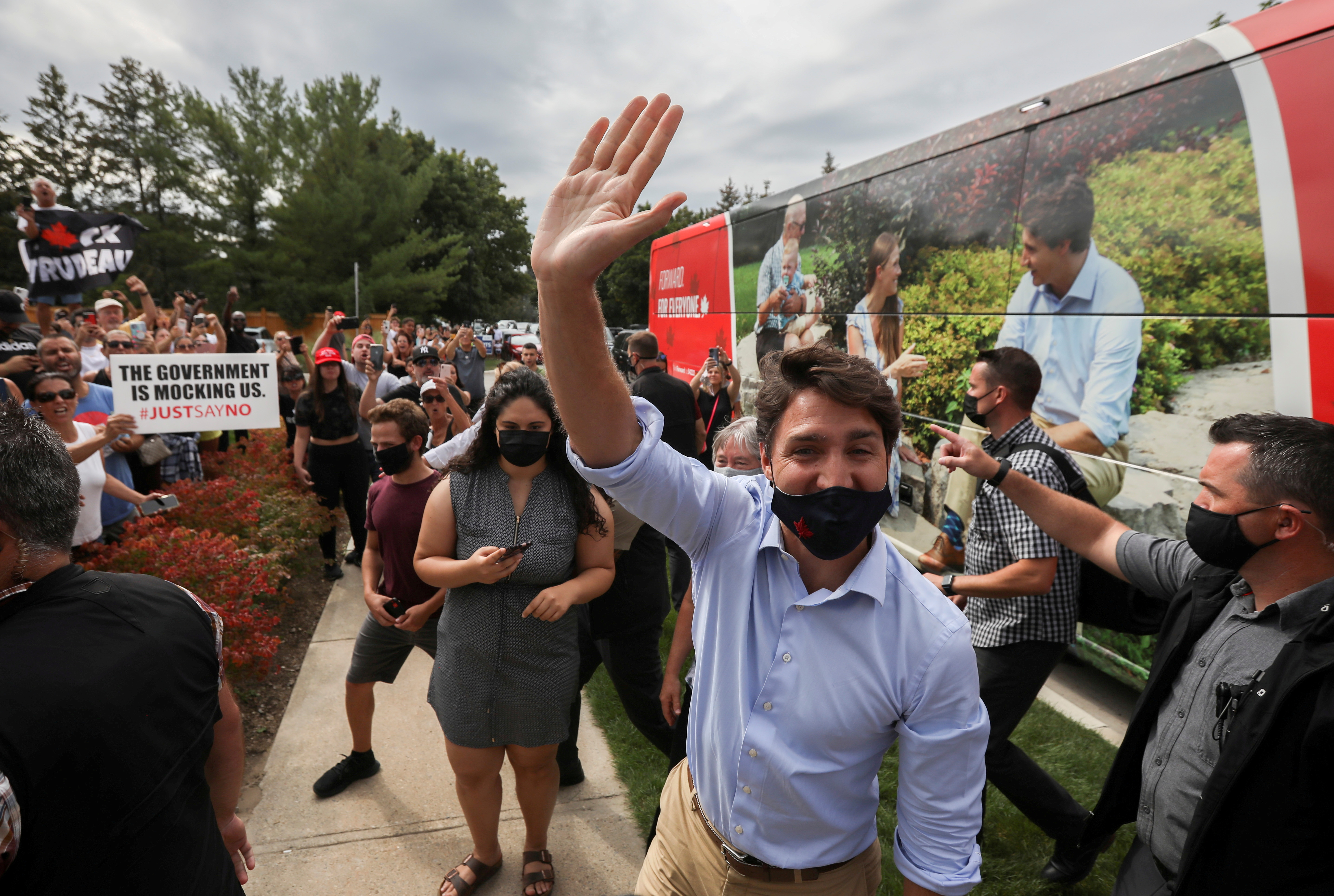 Canada's Liberal Prime Minister Justin Trudeau waves during his election campaign tour in Nobleton, Ontario, Canada August 27, 2021. REUTERS/Carlos Osorio