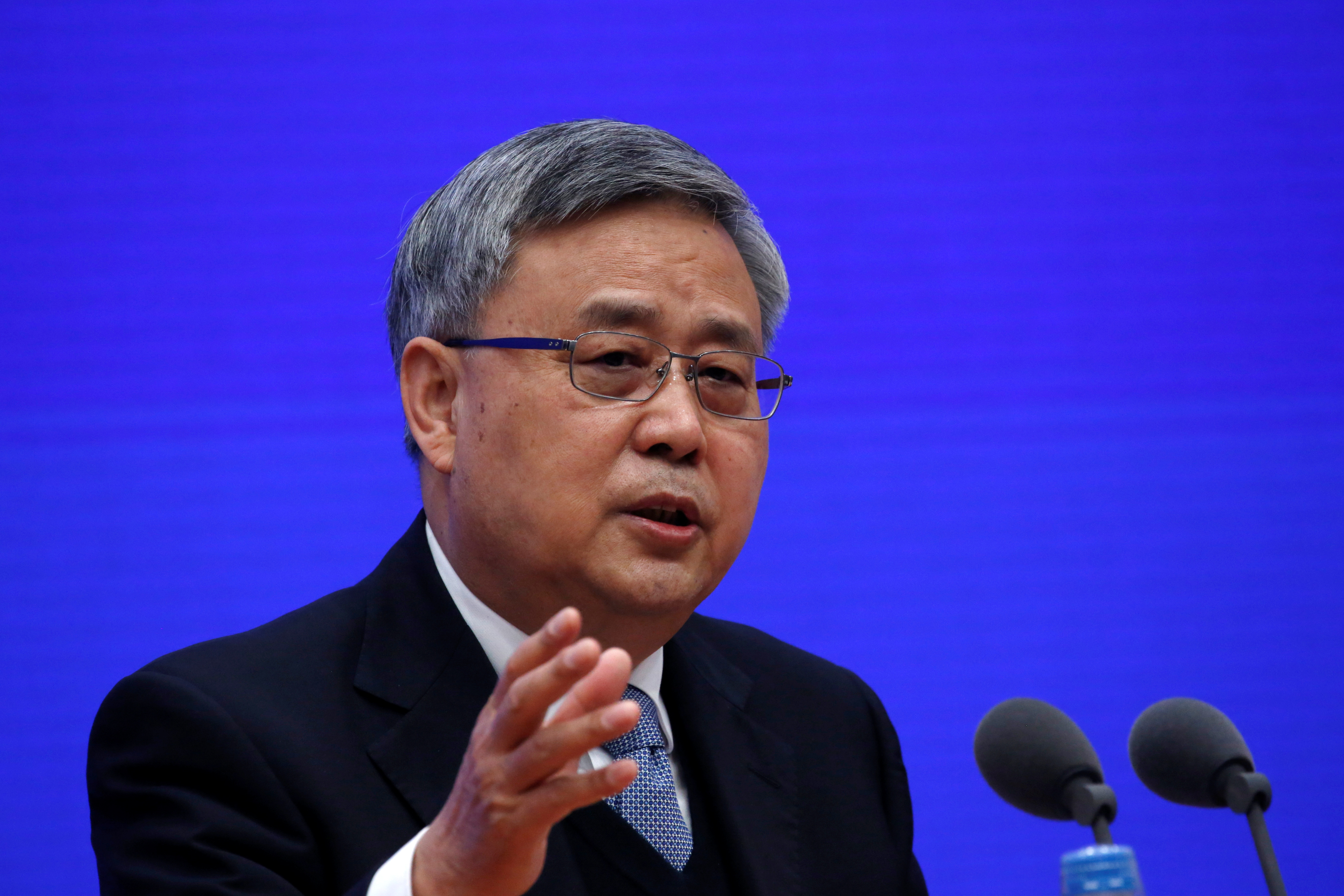 Guo Shuqing, Chairman of the China Banking and Insurance Regulatory Commission (CBIRC), attends a news conference in Beijing, China March 2, 2021. REUTERS/Tingshu Wang