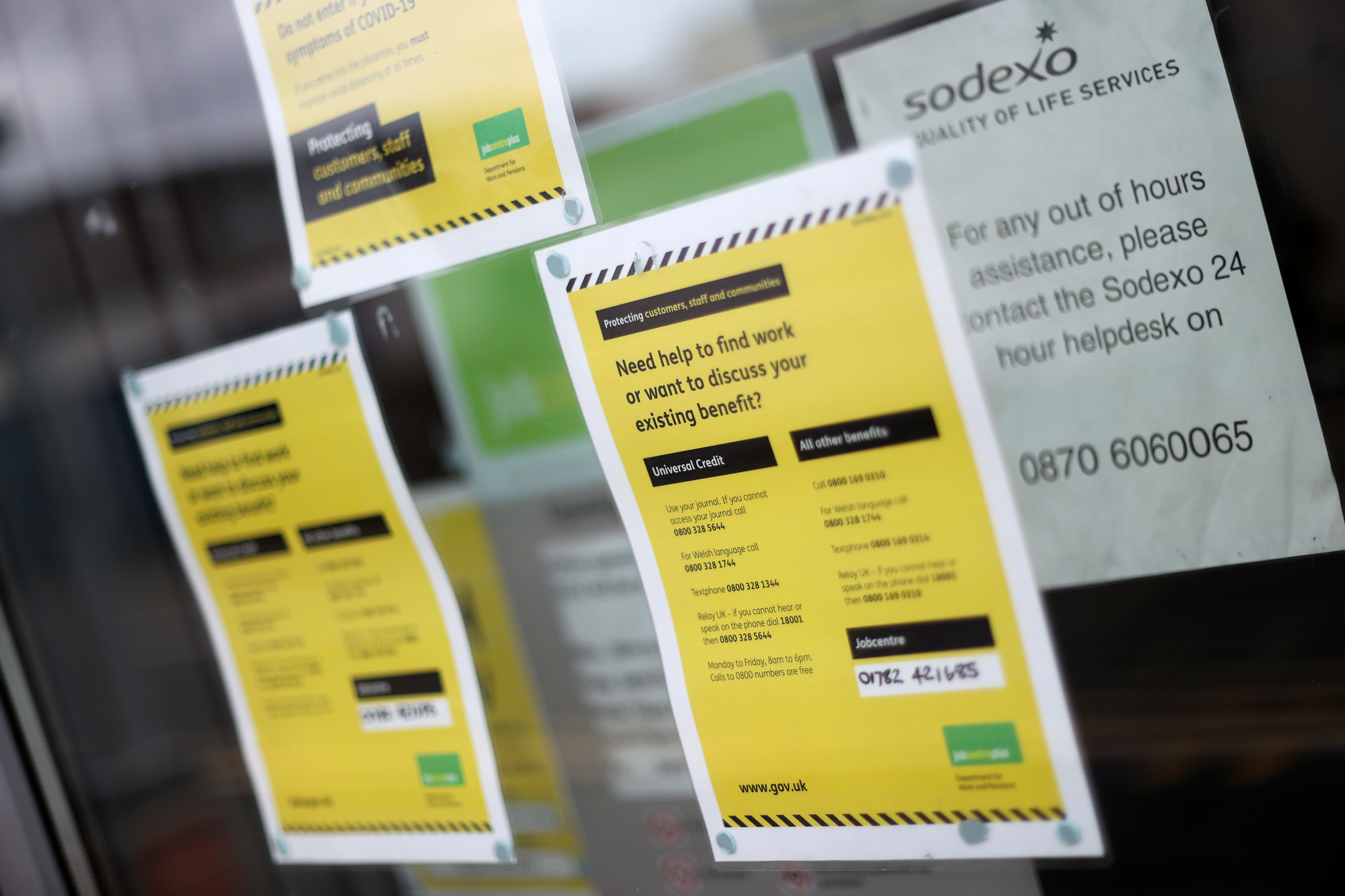 Advertisements for jobs are seen in a Job Recruitment Centre's window, amid the coronavirus disease (COVID-19) outbreak, in Stoke-on-Trent, Staffordshire, Britain August 6, 2020. REUTERS/Carl Recine