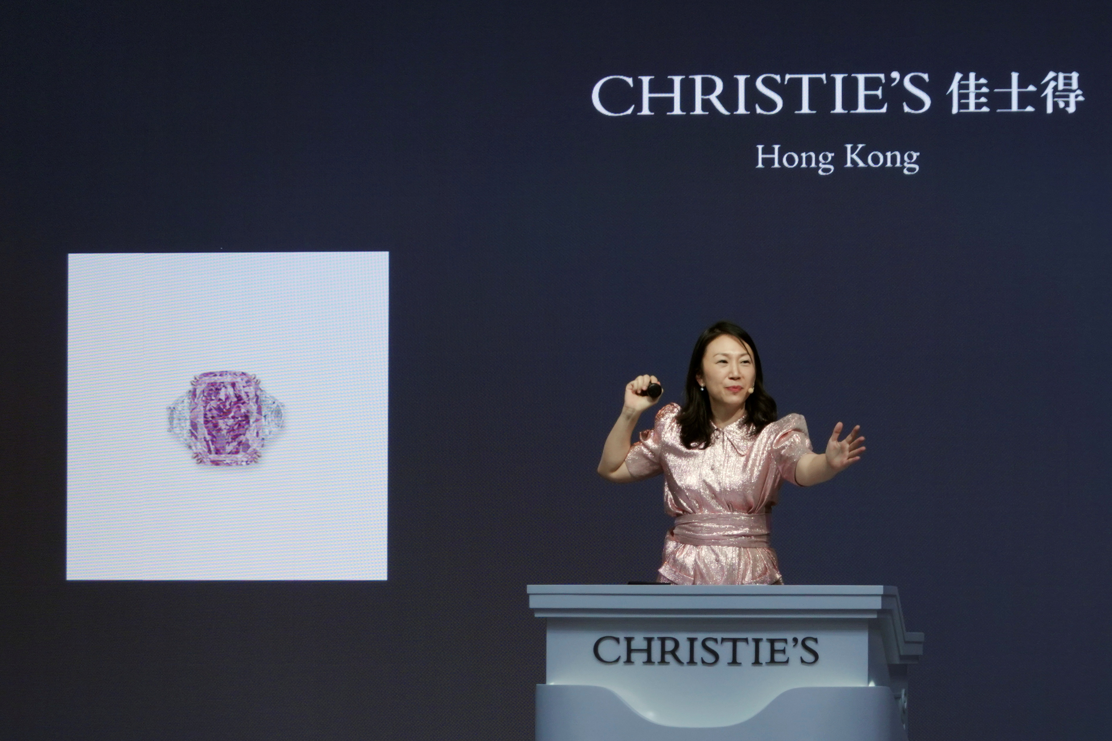 An auctioneer holds the gavel during Christie's auction of Sakura Diamond, a 15.81 carat purple pink diamond ring, in Hong Kong, China May 23, 2021. REUTERS/Joyce Zhou