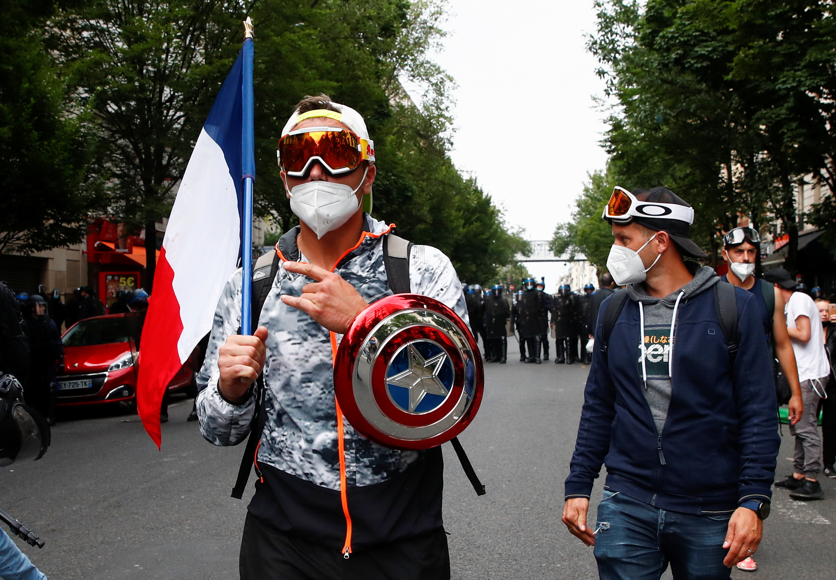 Demonstrators take part in a protest against the new measures announced by French President Emmanuel Macron to fight the coronavirus disease (COVID-19) outbreak, in Paris, France, July 14, 2021. REUTERS/Gonzalo Fuentes