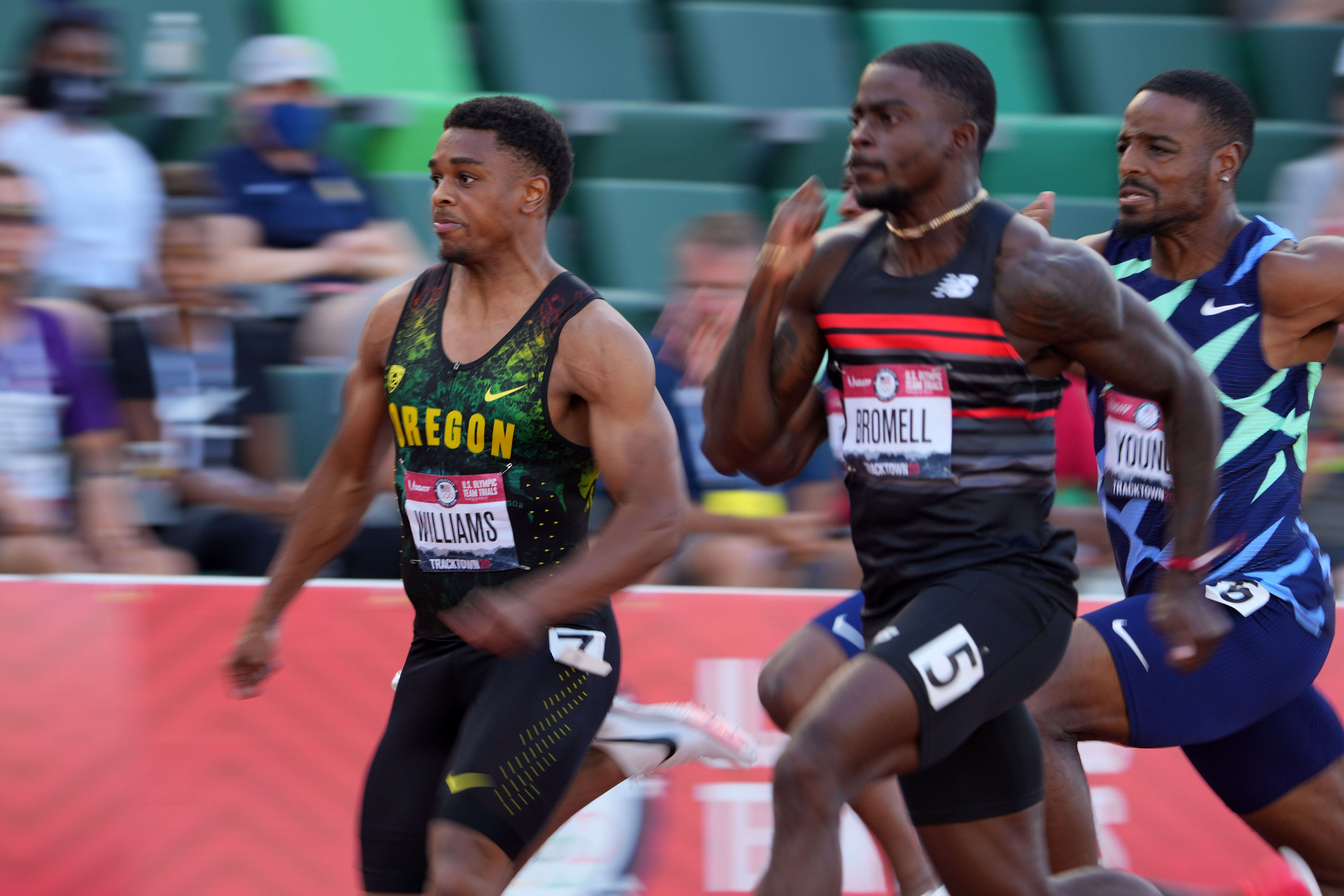 Jun 20, 2021; Eugene, OR, USA; Micah Wiliams of Oregon and Trayvon Bromell run in a 100m semifinal during the US Olympic Team Trials at Hayward Field. Mandatory Credit: Kirby Lee-USA TODAY Sports