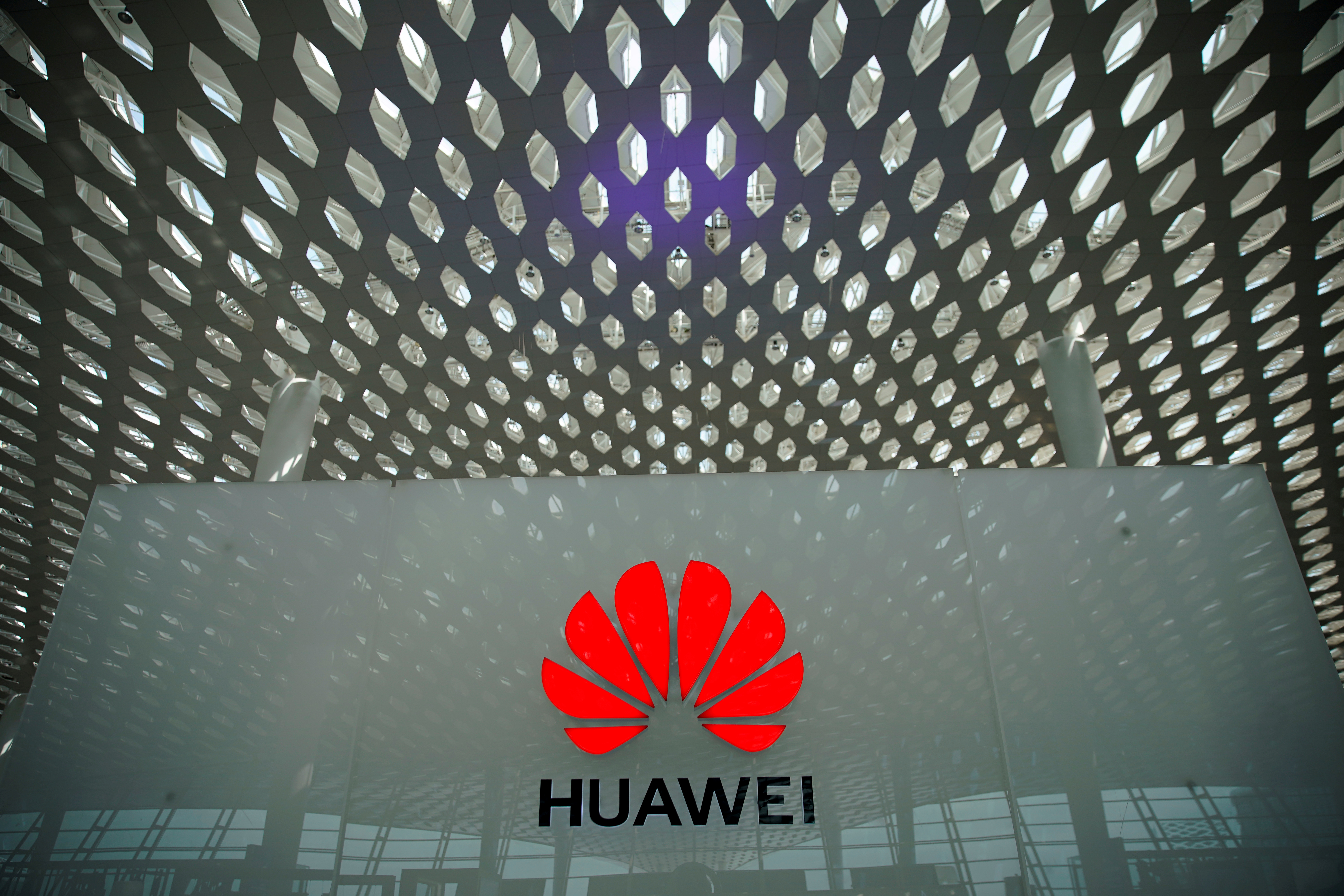 A Huawei company logo at the Shenzhen International Airport in Shenzhen, Guangdong province, China June 17, 2019. REUTERS/Aly Song/File Photo/File Photo