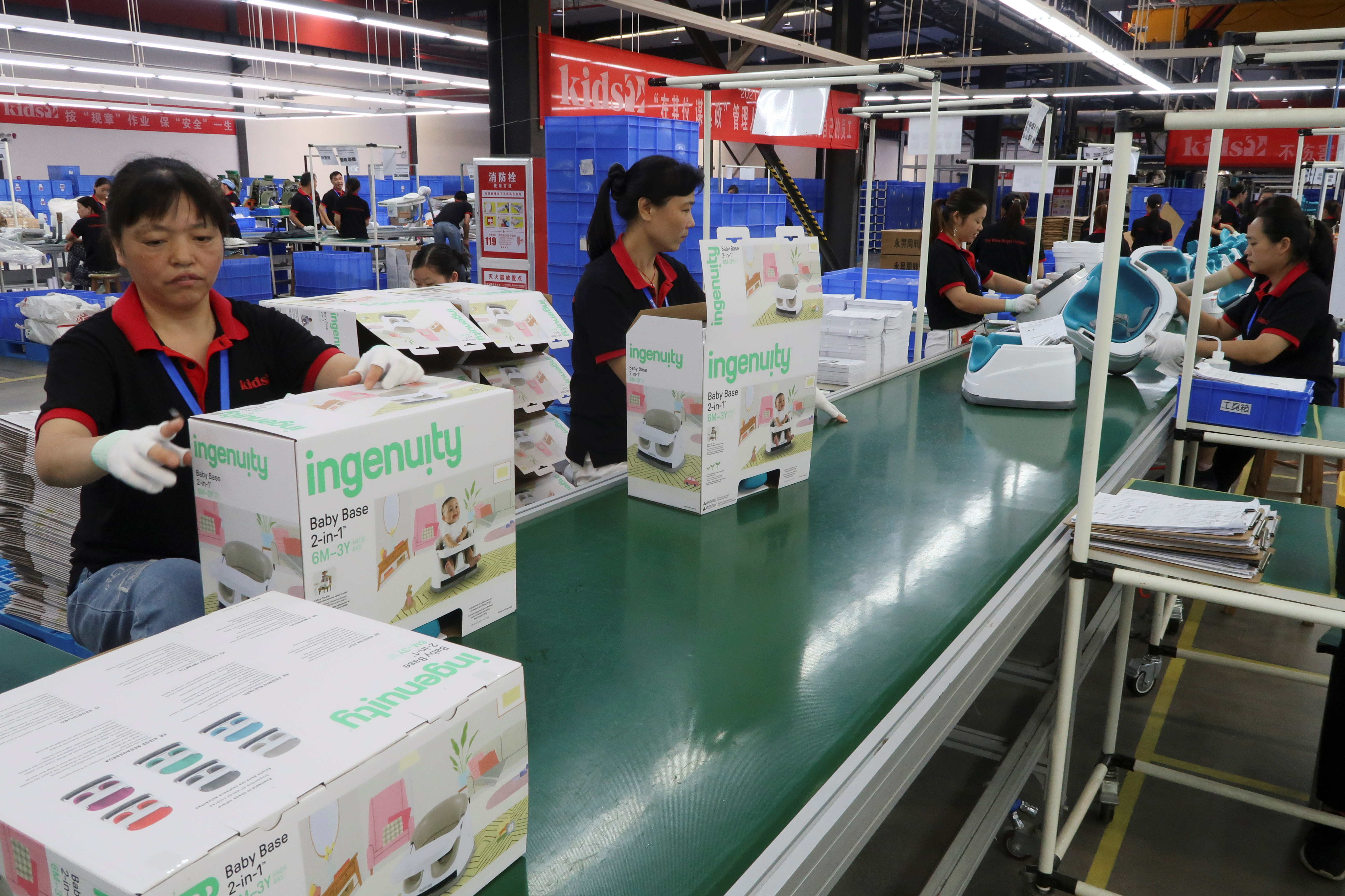 Employees work on the production line of American infant product and toy manufacturer Kids II Inc. at a factory in Jiujiang, Jiangxi province, China June 22, 2021. Picture taken June 22, 2021. REUTERS/Gabriel Crossley