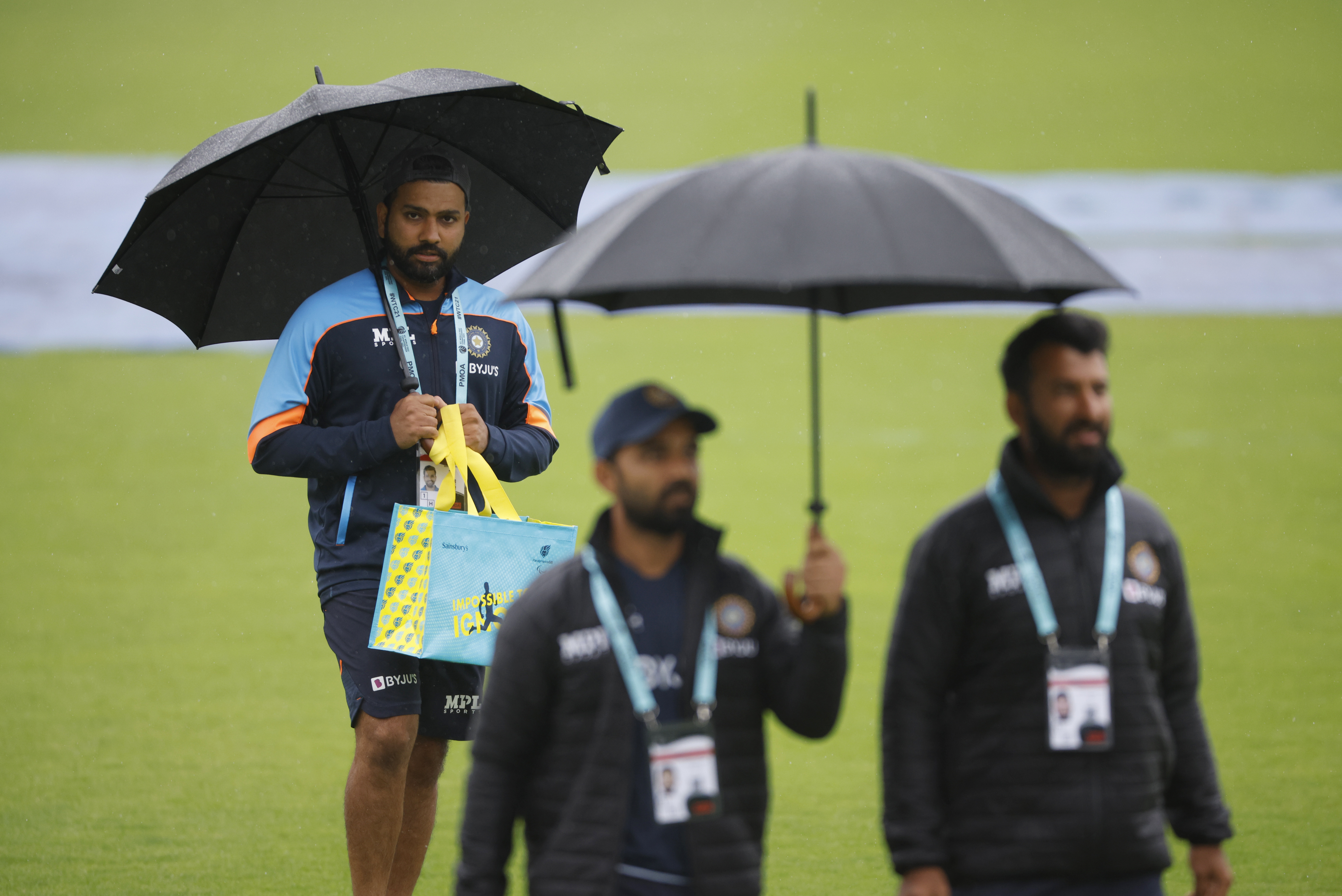 Cricket - ICC World Test Championship Final - India v New Zealand - Rose Bowl, Southampton, Britain - June 21, 2021 India's Rohit Sharma walks on the field as rain delays play Action Images via Reuters/John Sibley