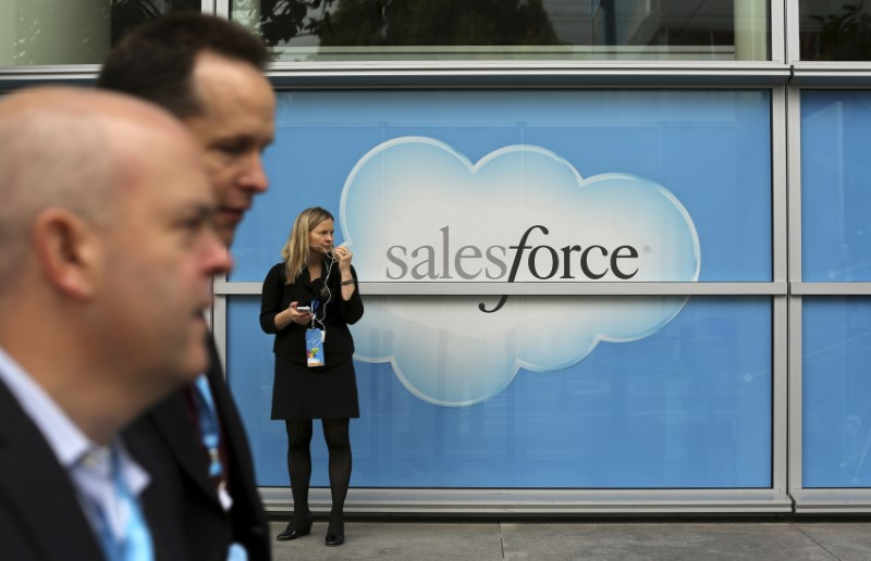 A woman stands near a Salesforce sign during the company's annual Dreamforce event, in San Francisco, California November 18, 2013.  REUTERS/Robert Galbraith