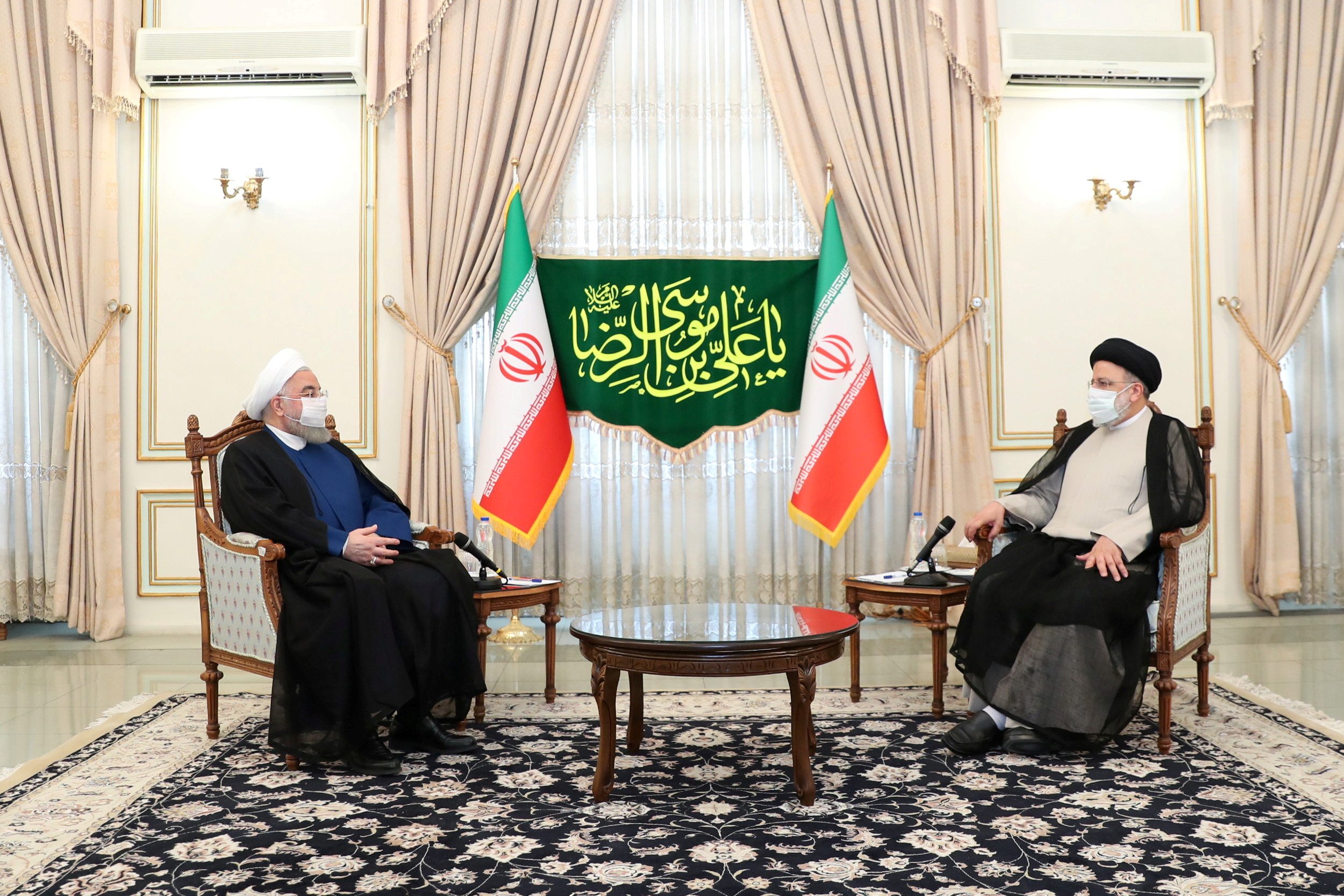 Iran's outgoing President Hassan Rouhani meets with Iran's President-elect Ebrahim Raisi in Tehran, Iran June 19, 2021. Official Presidential website/Handout via REUTERS