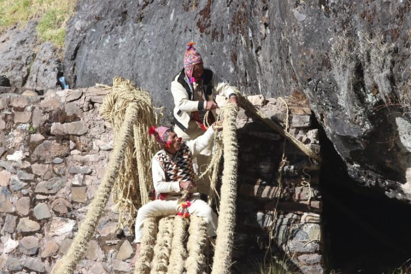 Members of the Huinchiri community rebuild an Incan hanging bridge, known as the Qeswachaka bridge, using traditional weaving techniques in Canas, Peru, June 13, 2021. Picture taken June 13, 2021. Cusco Regional Government/Handout via REUTERS