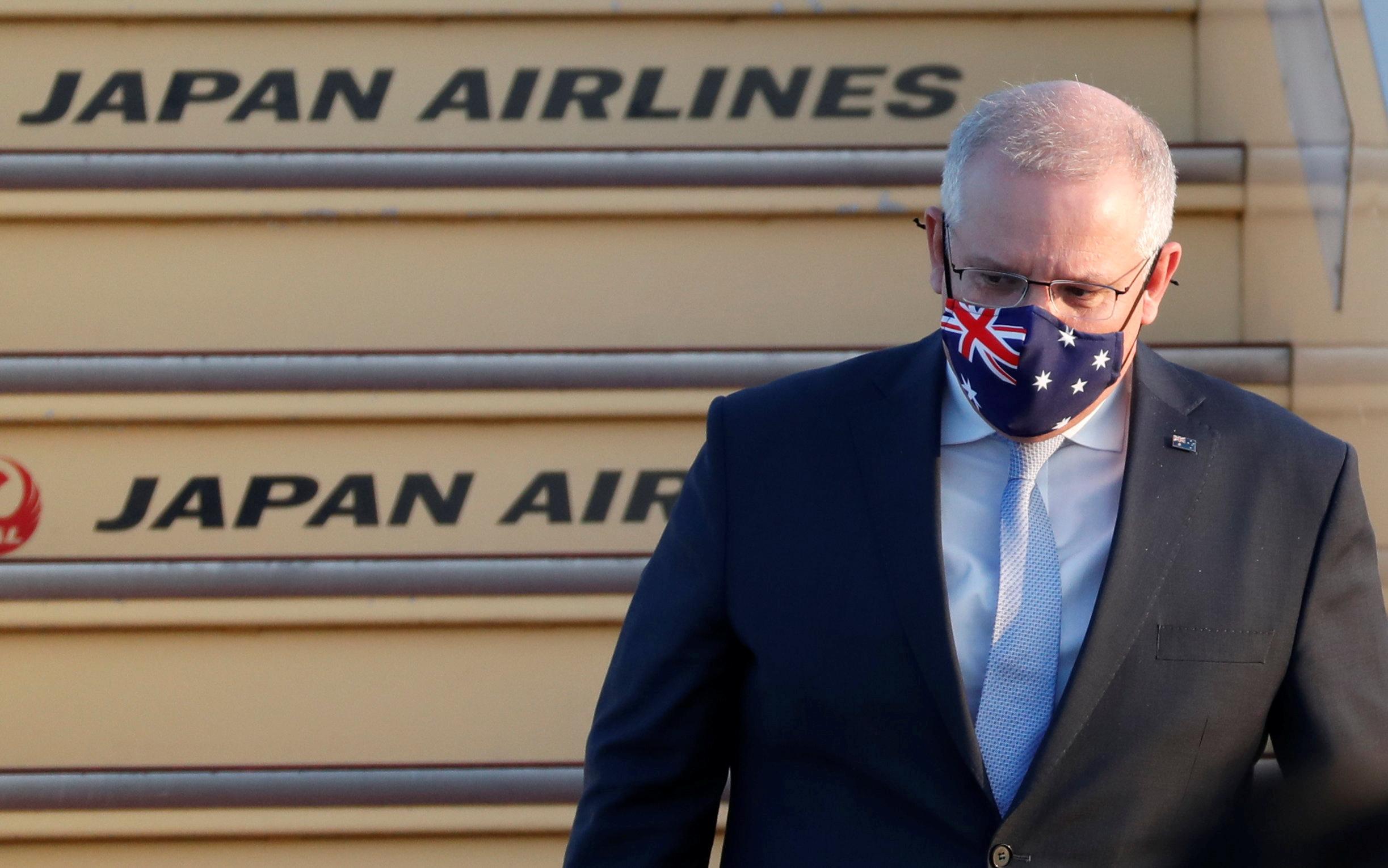 Australian Prime Minister Scott Morrison arrives at Haneda airport in Tokyo, Japan, November 17, 2020.  REUTERS/Issei Kato