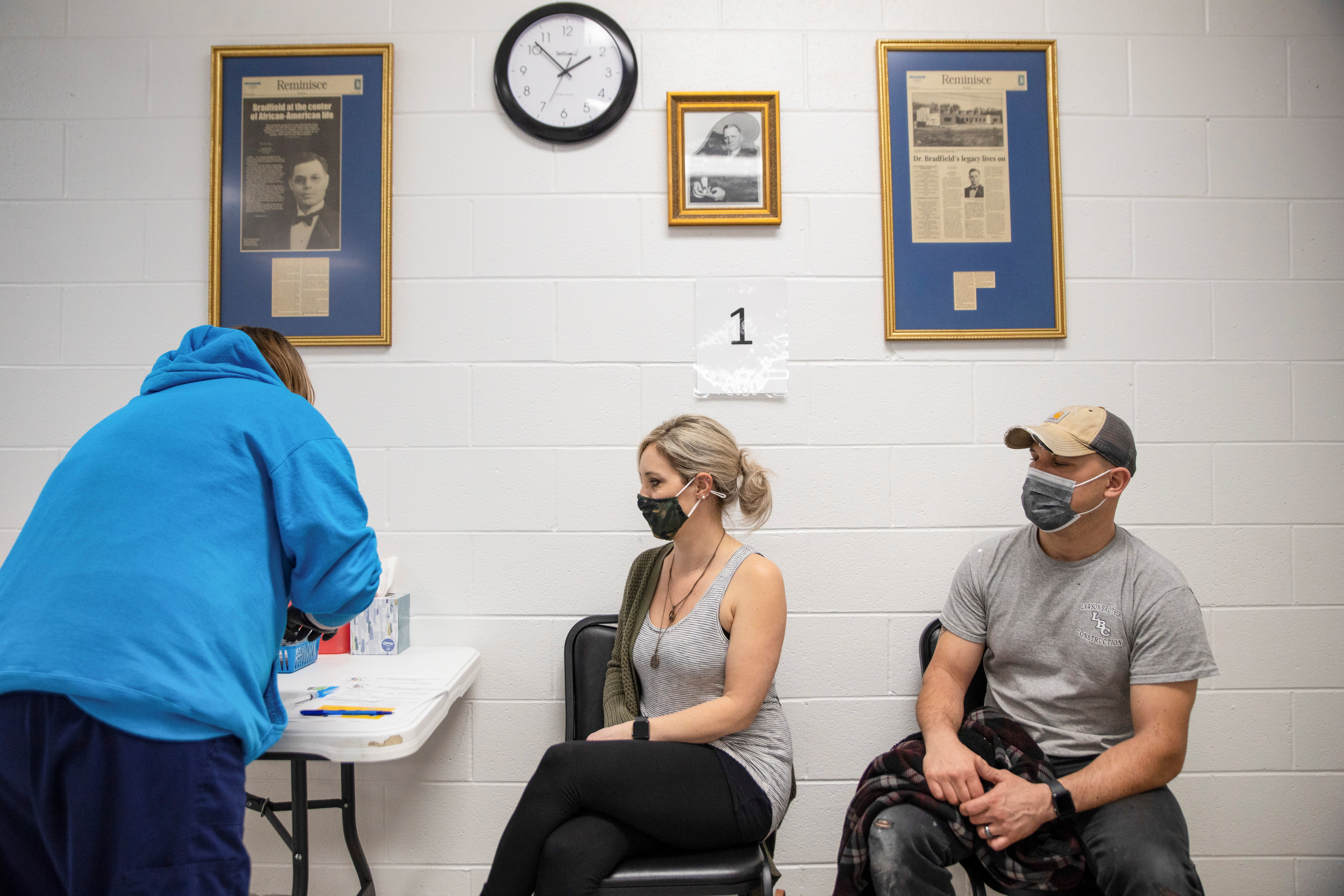 Stefanie Dunahay, 39, and Matt Dunahay, 39, wait to receive their coronavirus disease (COVID-19) vaccine as vaccine eligibility expands to anyone over the age of 16 at the Bradfield Community Center through Health Partners of Western Ohio in Lima, Ohio, U.S., March 29, 2021.  REUTERS/Megan Jelinger/File Photo