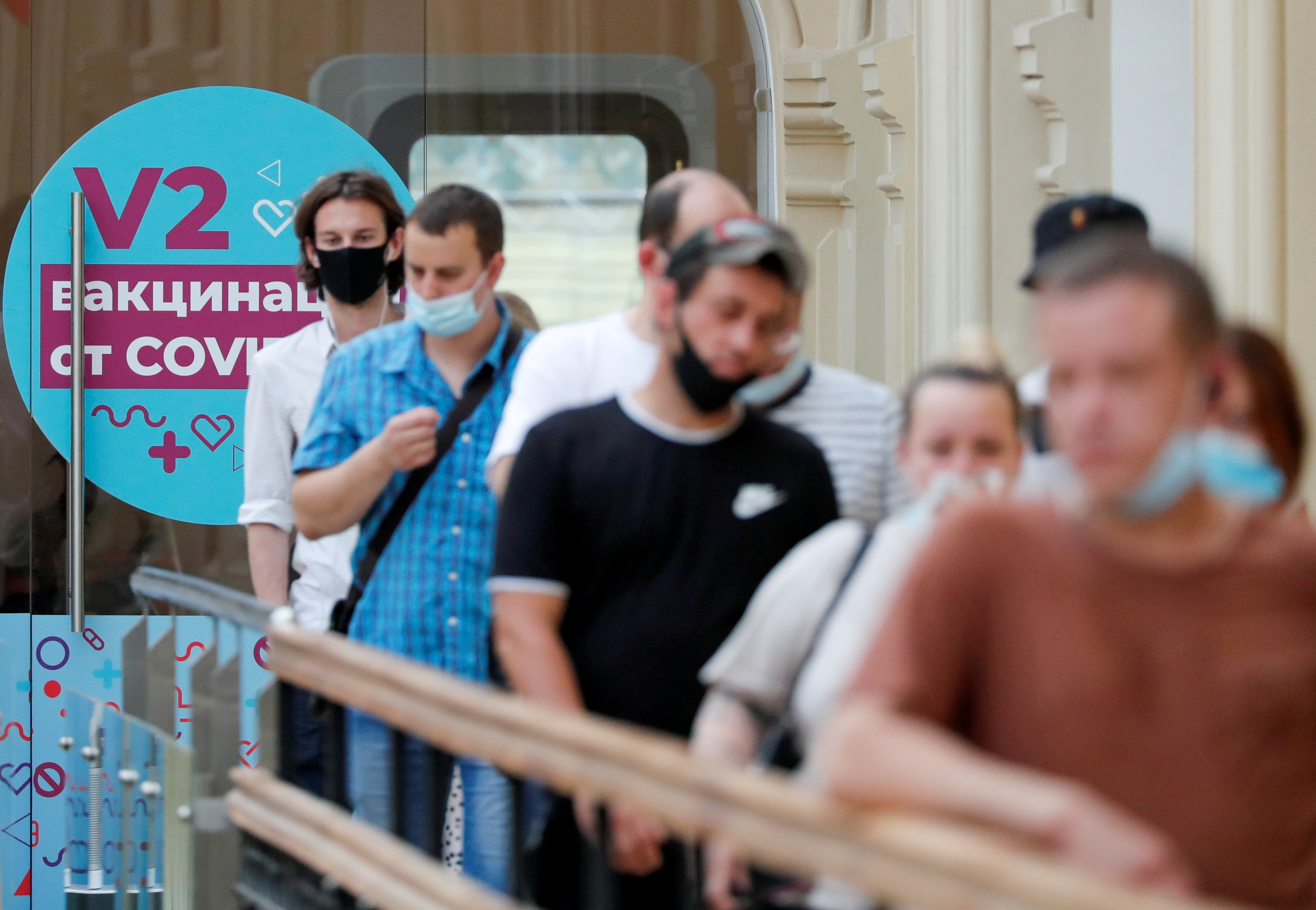 People line up to receive vaccine against the coronavirus disease (COVID-19) outside a vaccination centre in the State Department Store, GUM, in central Moscow, Russia June 25, 2021. REUTERS/Shamil Zhumatov