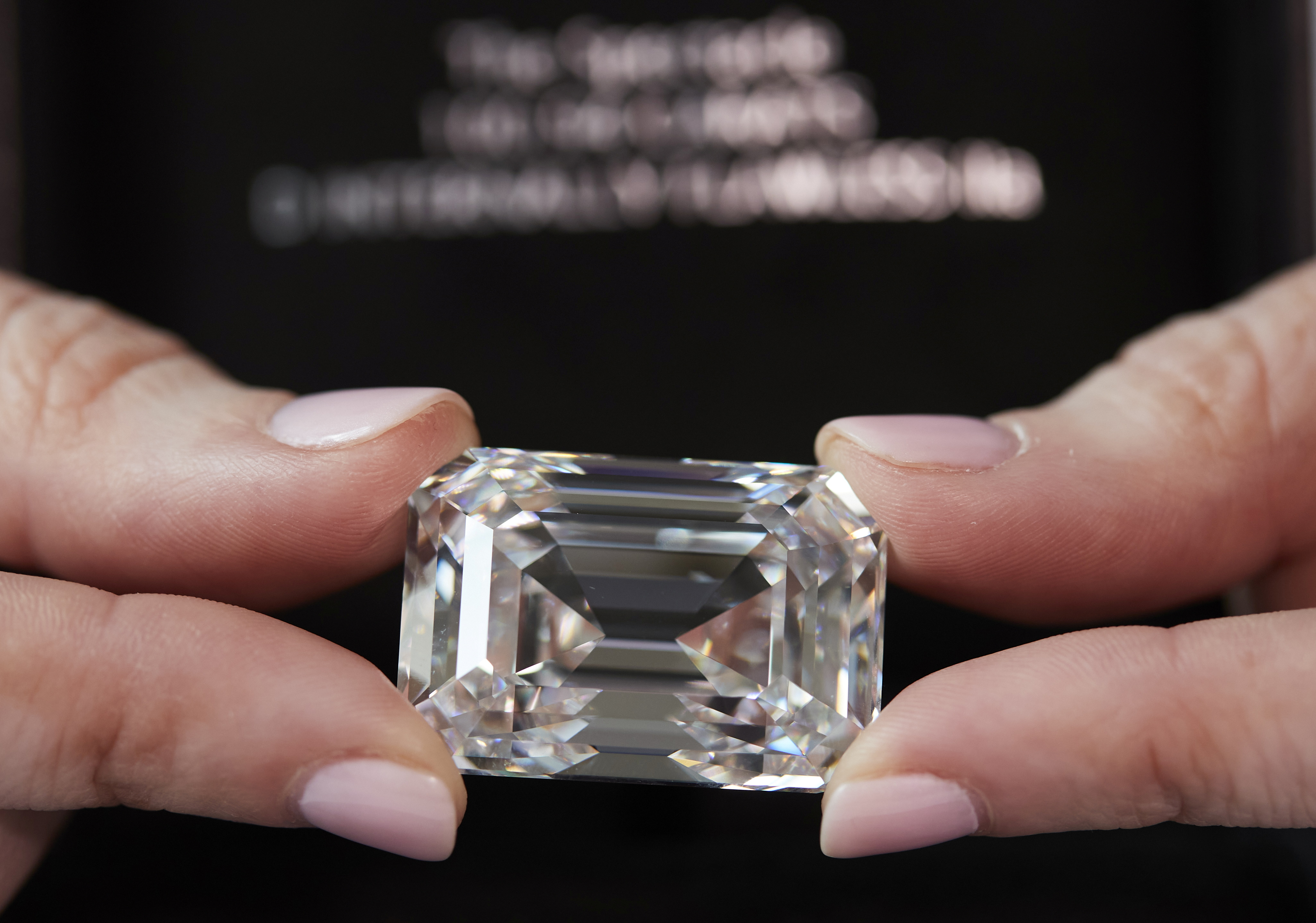 A staff holds a D colour, internally flawless rectangular step-cut diamond of 100.94 carats during a preview at Christie's before its auction sale in Geneva, Switzerland, May 7, 2021.  REUTERS/Denis Balibouse