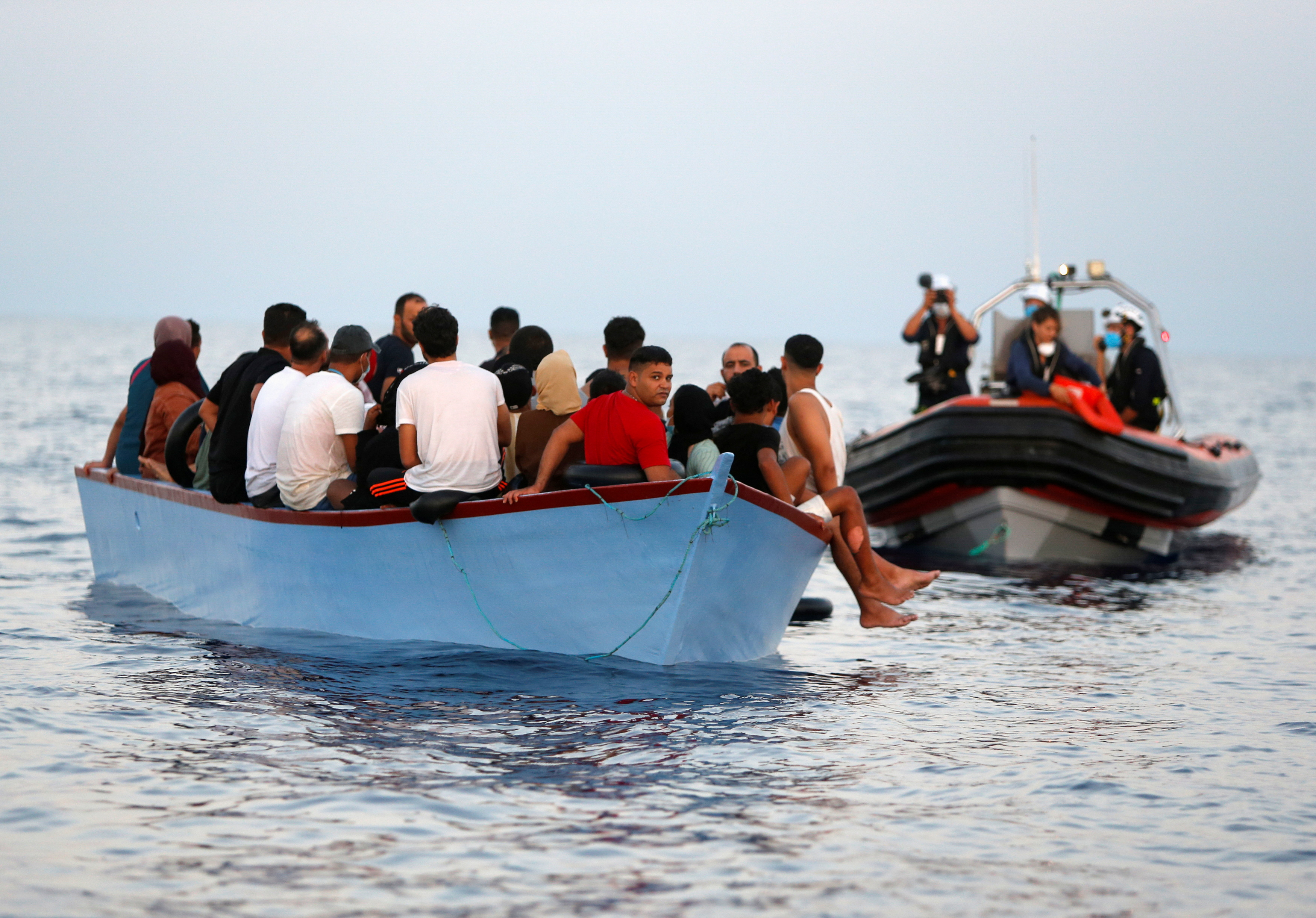 Migrants wait in a boat to be rescued by the crew of the German NGO migrant rescue ship Sea-Watch 3 in international waters off the coast of Libya, in the western Mediterranean Sea, July 30, 2021.  REUTERS/Darrin Zammit Lupi