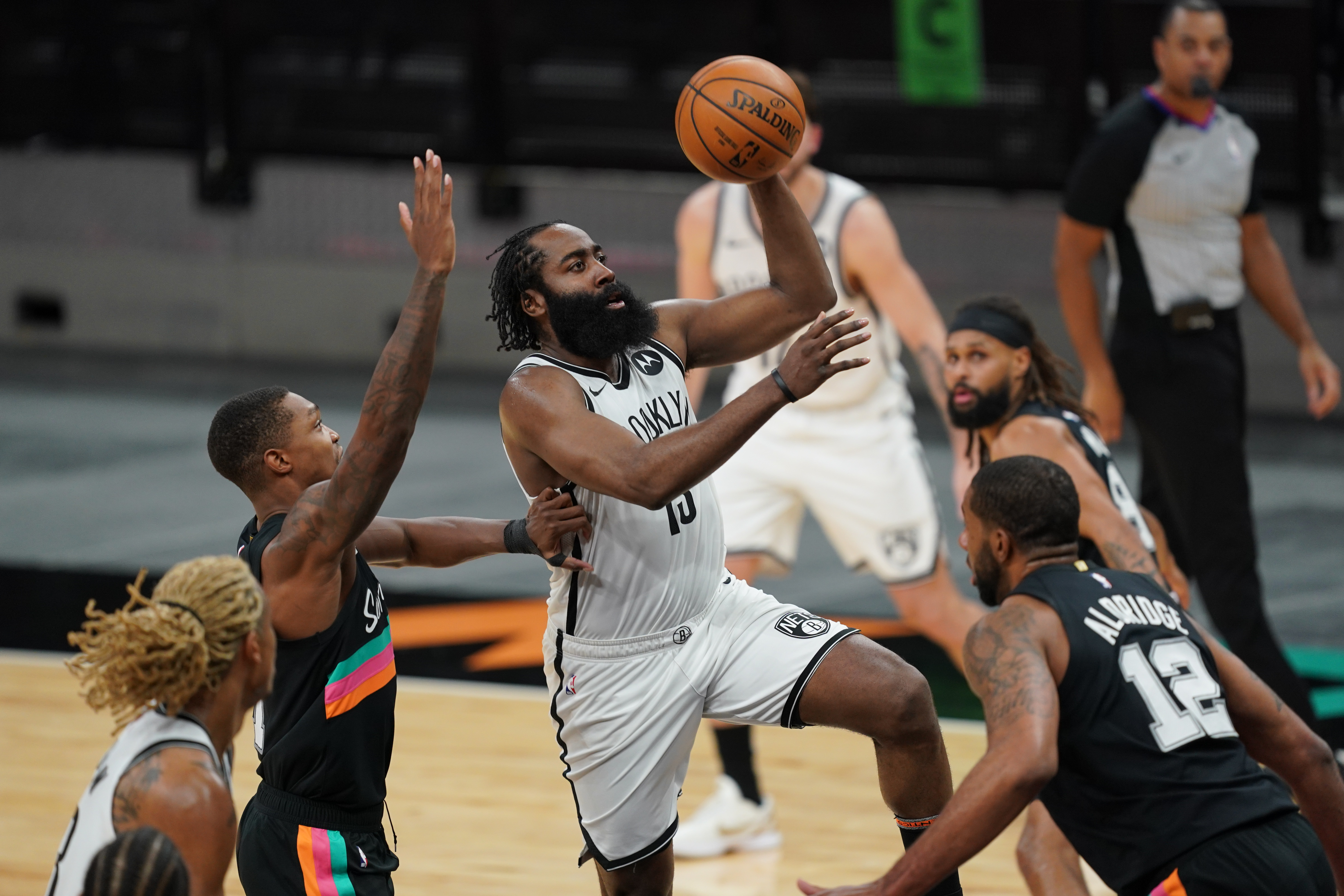 Mar 1, 2021; San Antonio, Texas, USA;  Brooklyn Nets guard James Harden (13) shoots in the second half against the San Antonio Spurs at the AT&T Center. Mandatory Credit: Daniel Dunn-USA TODAY Sports