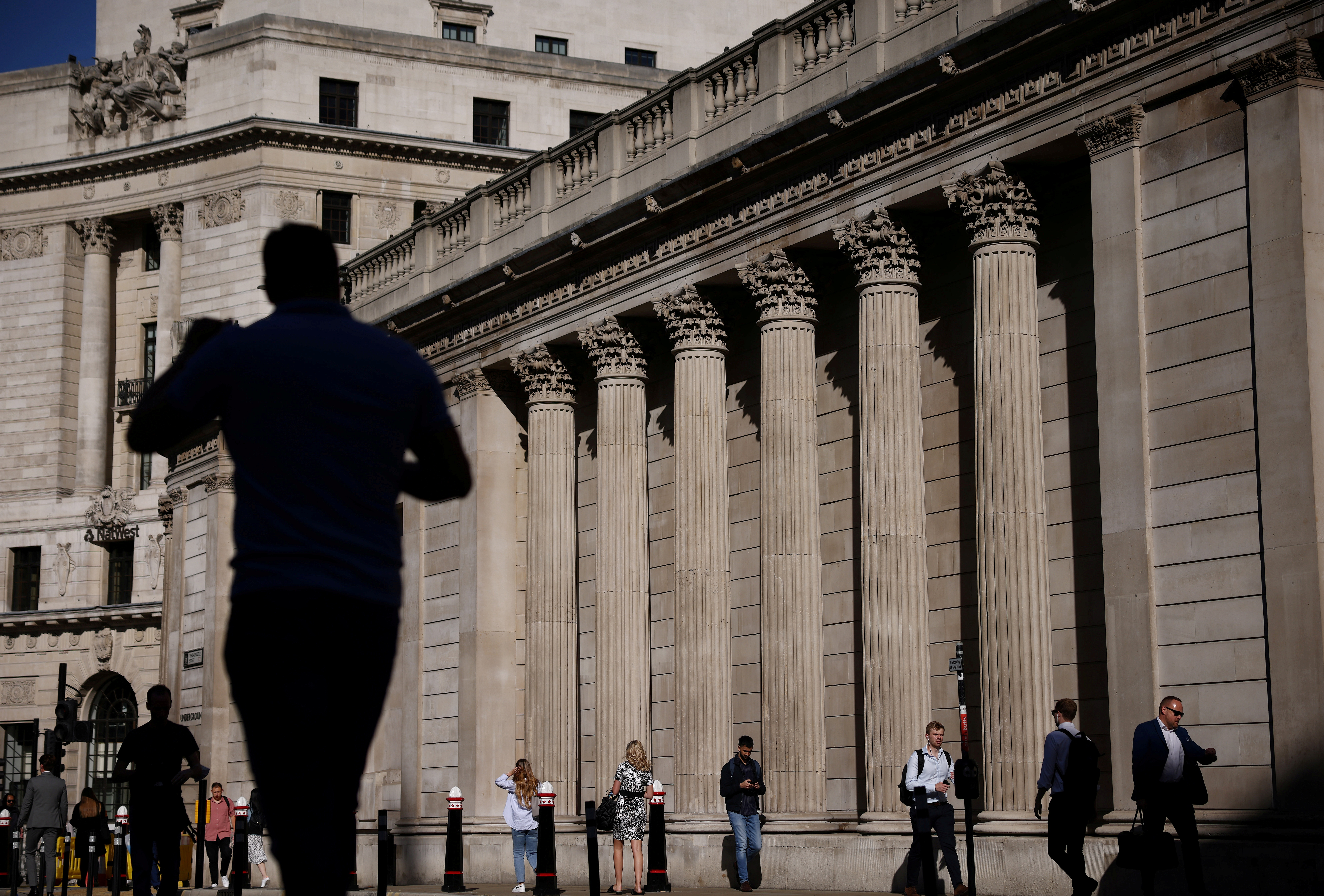 People walk past the Bank of England during morning rush hour, amid the coronavirus disease (COVID-19) pandemic in London, Britain, July 29, 2021. REUTERS/Henry Nicholls/File Photo