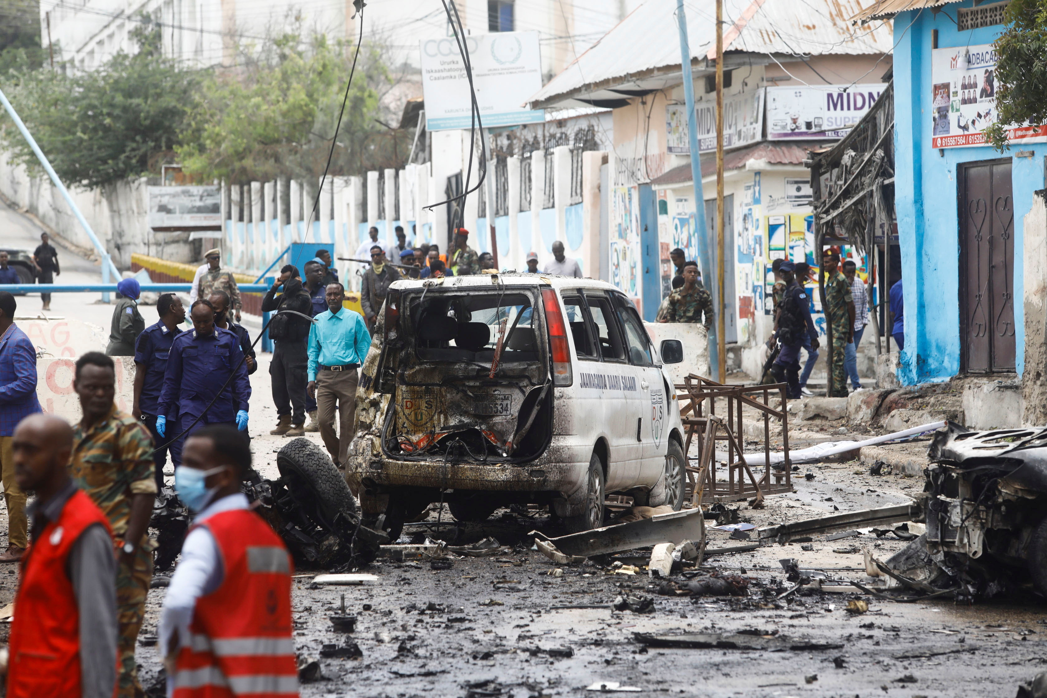 Somalian security officers gather at the scene of a suicide car bomb at a street junction near the president's residence, in Mogadishu, Somalia, September 25, 2021. REUTERS/Feisal Omar