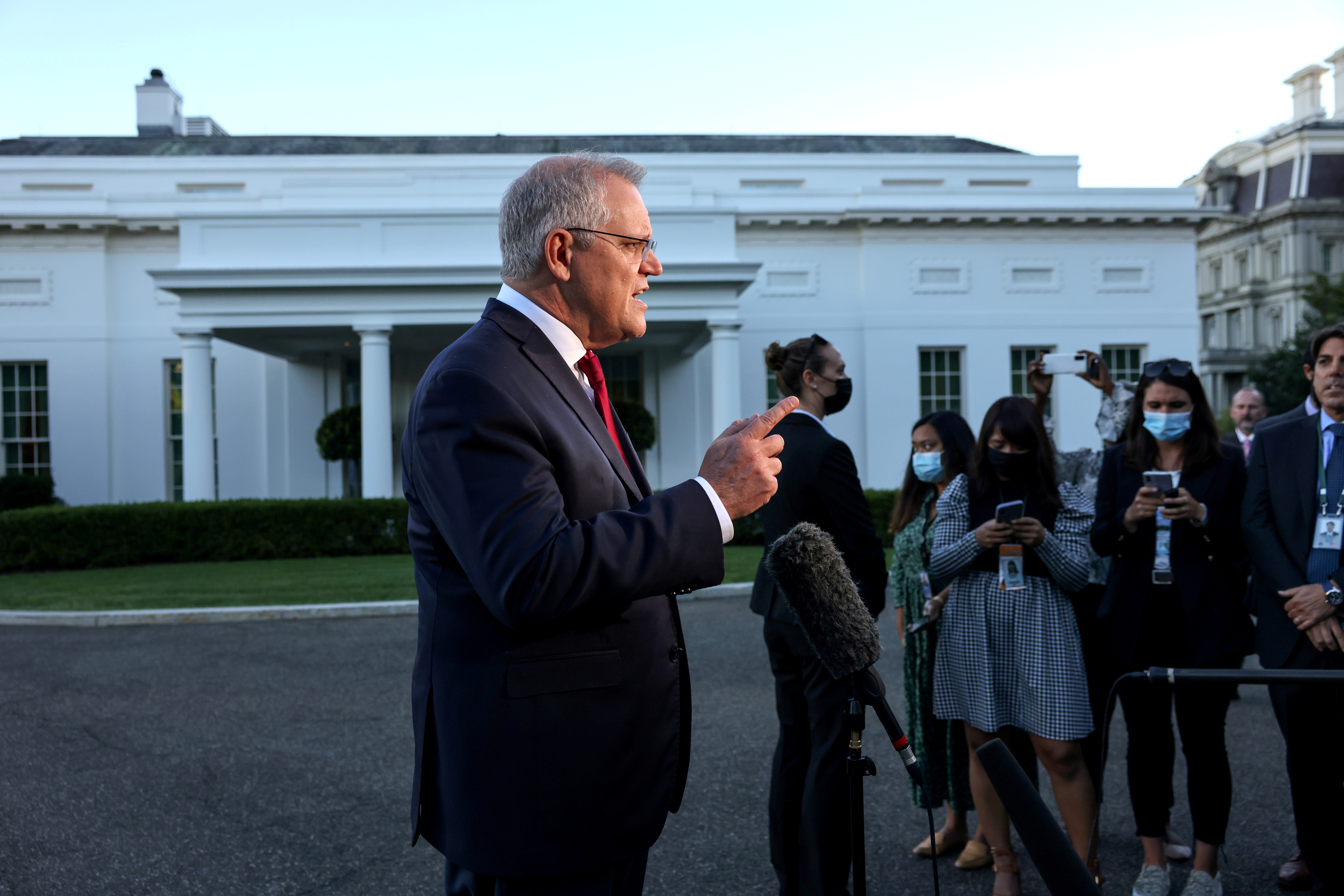 Australia's Prime Minister Scott Morrison speaks with the media following a day of meetings with foreign counterparts at the White House in Washington, U.S., September 24, 2021. REUTERS/Evelyn Hockstein/File Photo