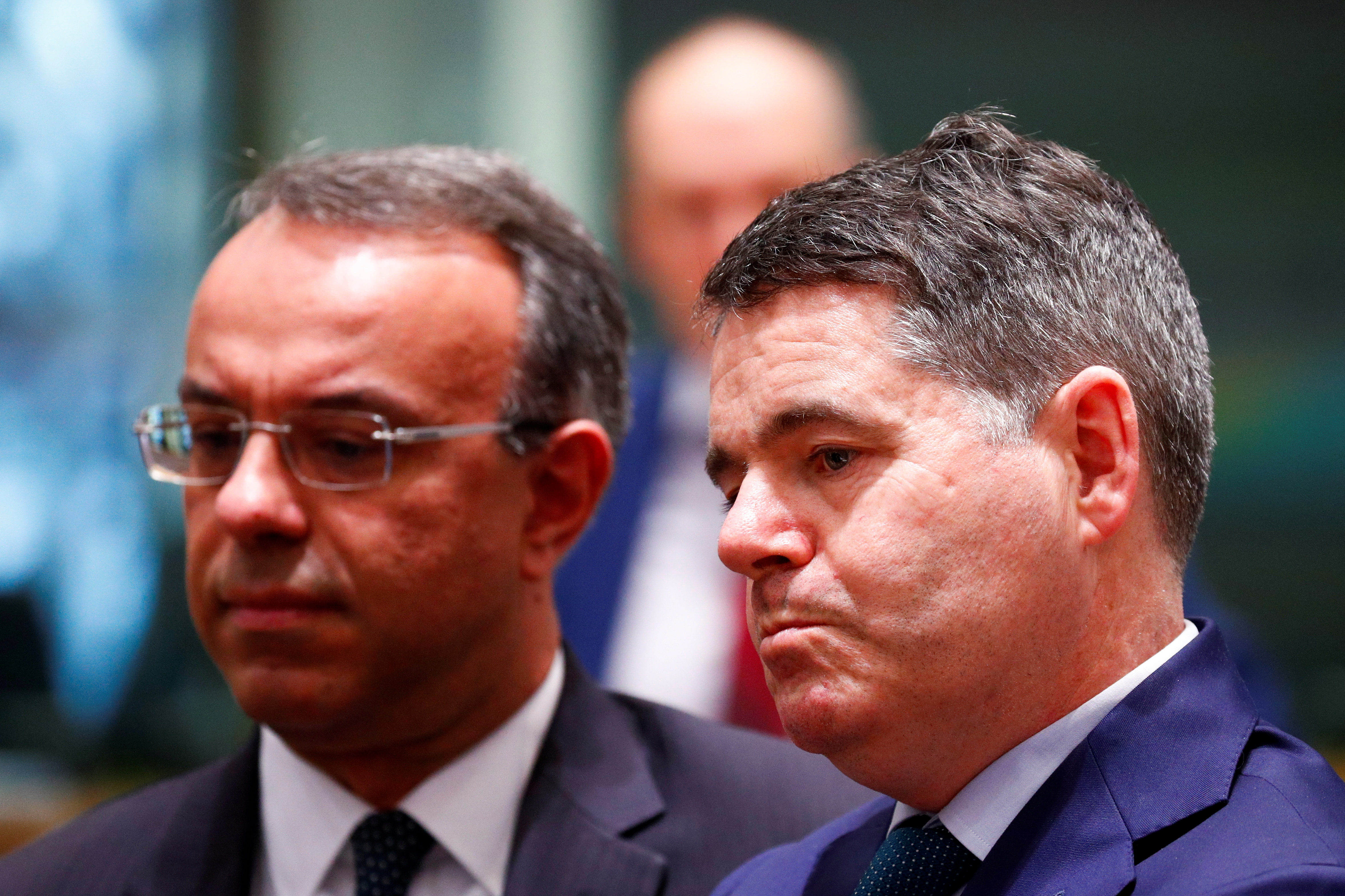 Irish Finance Minister Paschal Donohoe (R) and Greek Finance Minister Christos Staikouras attend a Euro zone finance ministers meeting in Brussels, Belgium, December 4, 2019. REUTERS/Francois Lenoir/File Photo