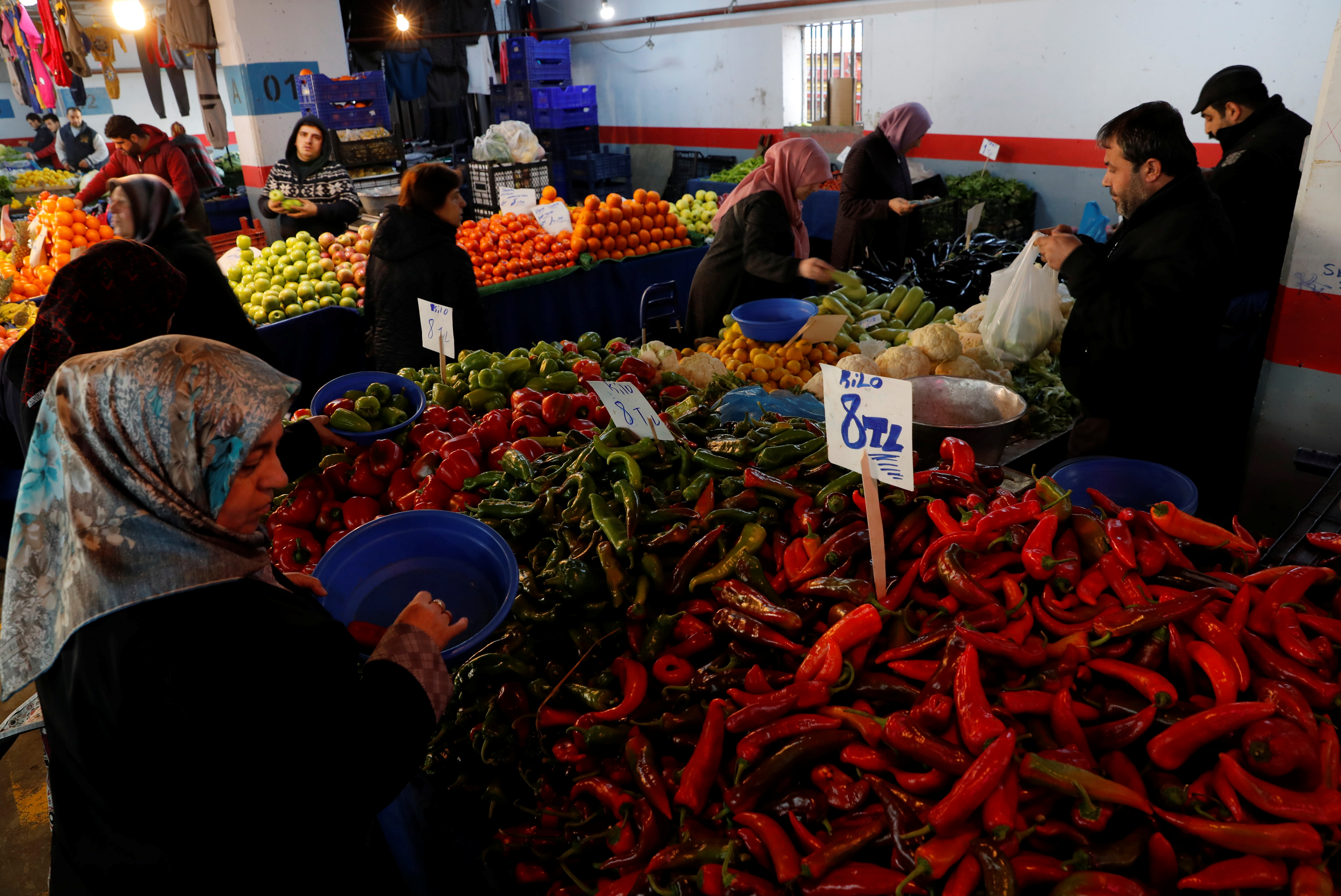 People shop at a food market in Istanbul, Turkey, February 11, 2019. REUTERS/Murad Sezer