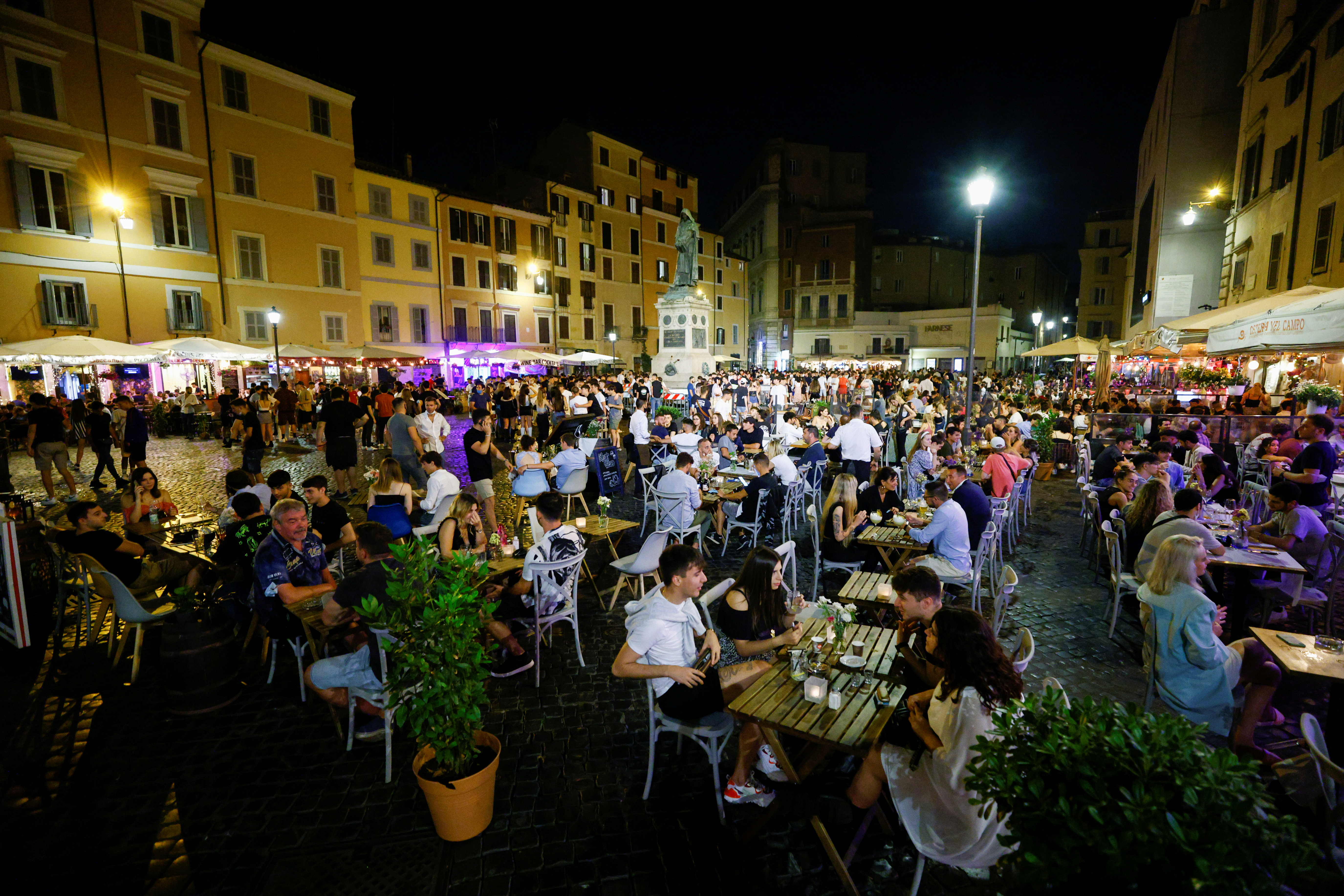 People gather in Campo de' Fiori as much of Italy becomes a low risk