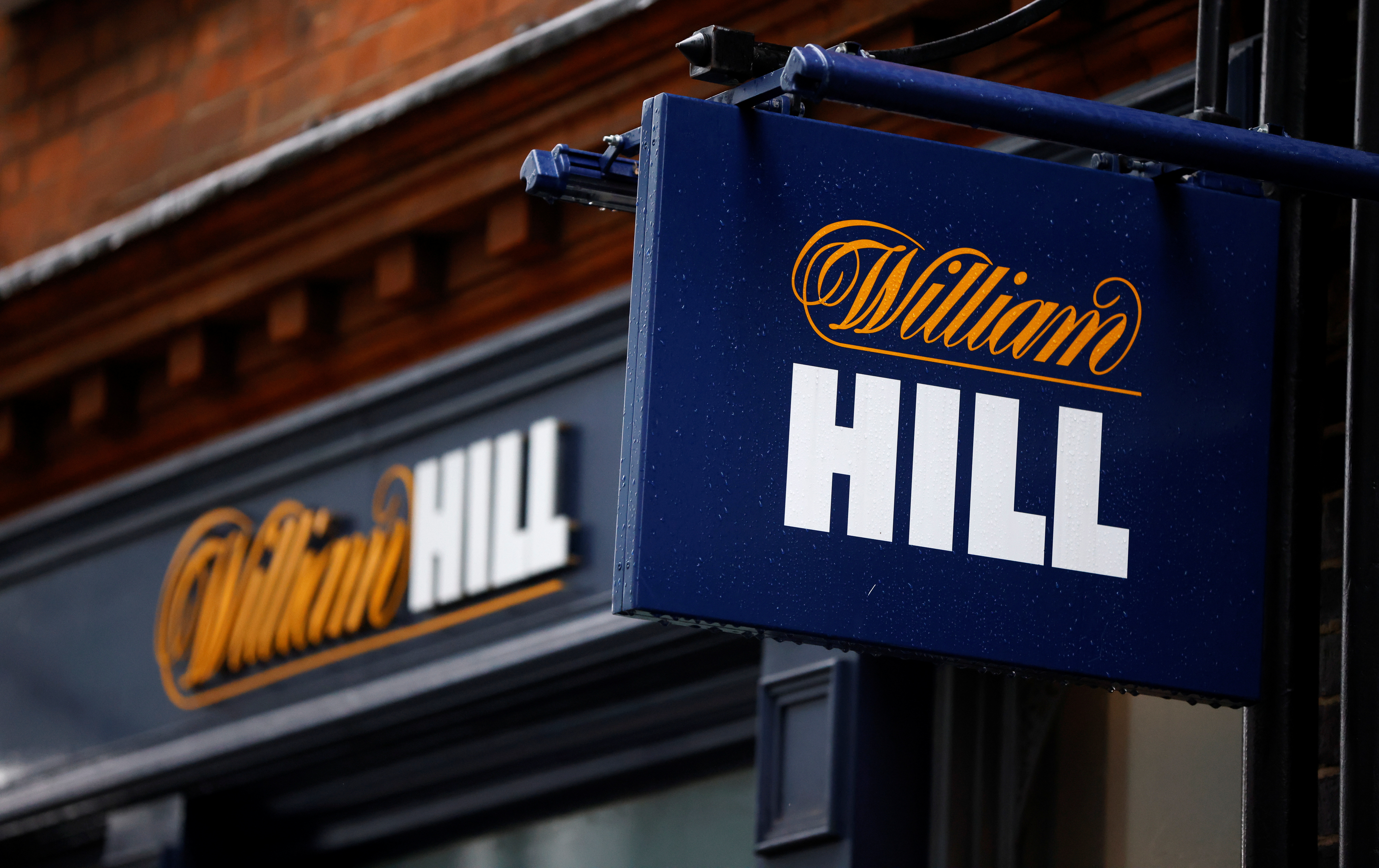 Signs are seen outside a branch of bookmaker William Hill in central London, Britain October 21, 2020. REUTERS/John Sibley
