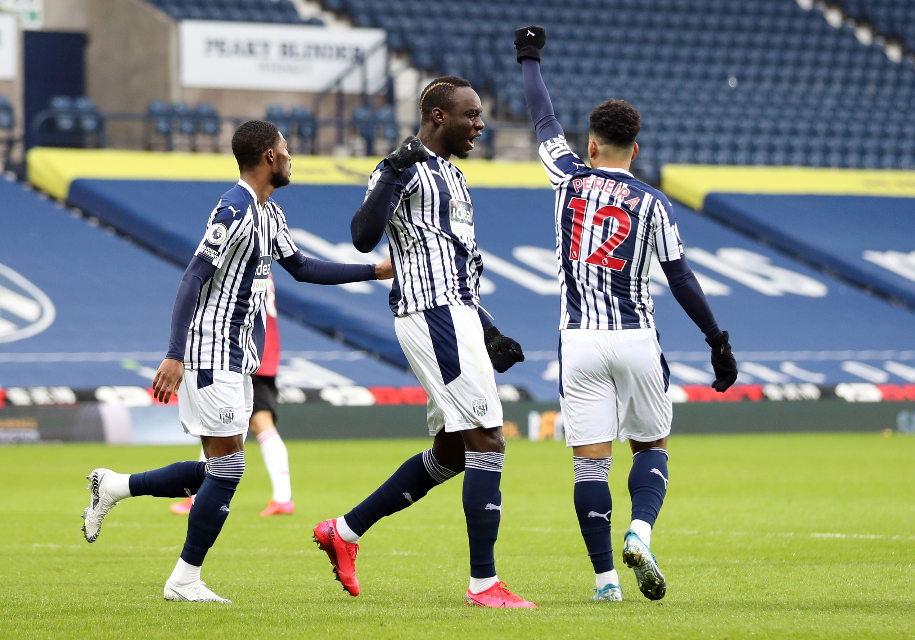Soccer Football - Premier League - West Bromwich Albion v Manchester United - The Hawthorns, West Bromwich, Britain - February 14, 2021 West Bromwich Albion's Mbaye Diagne celebrates scoring their first goal with teammates Pool via REUTERS/Naomi Baker