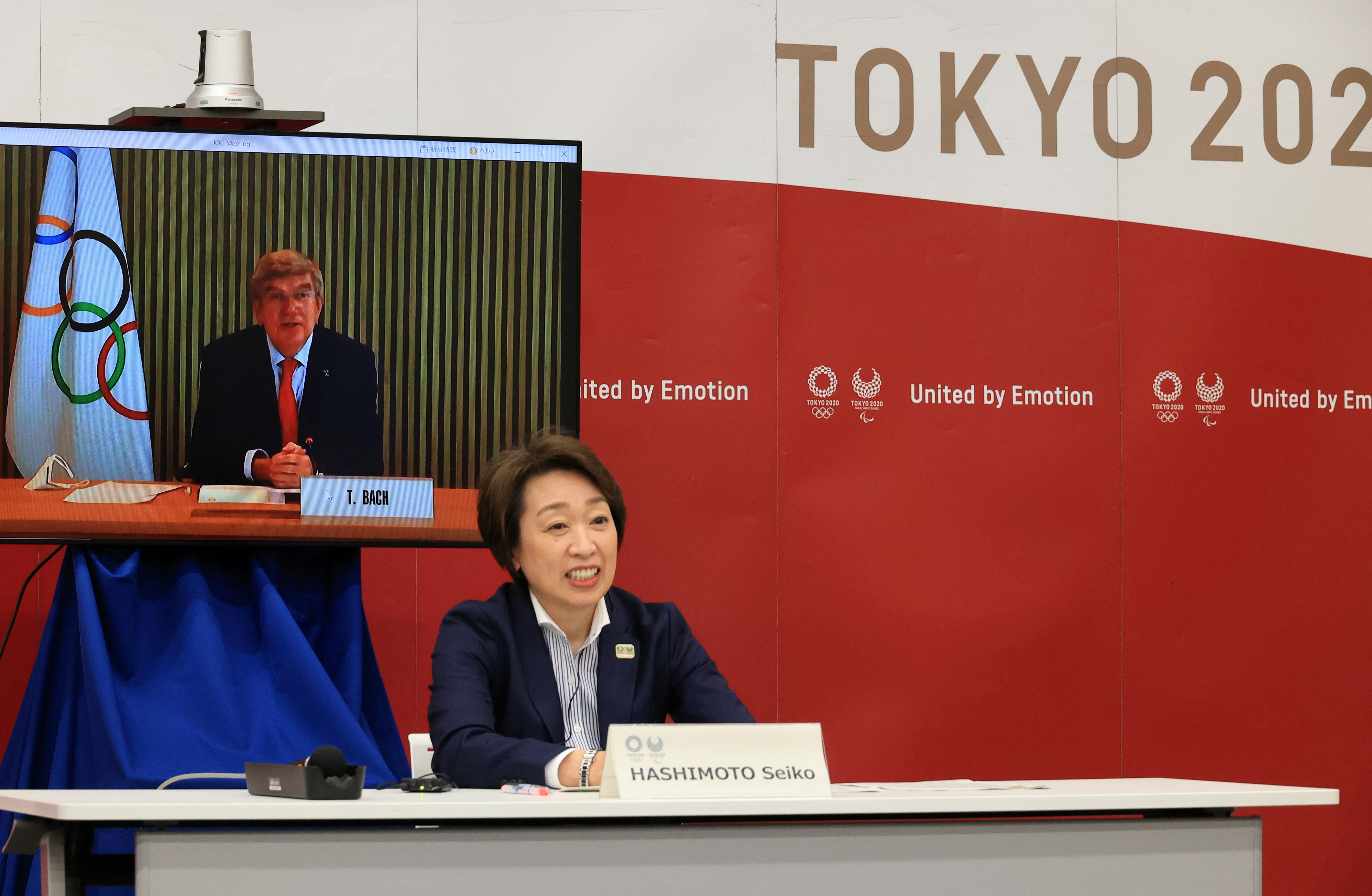 International Olympic Committee (IOC) President Thomas Bach (on a screen) delivers an opening speech while Tokyo 2020 Organizing Committee president Seiko Hashimoto listens, at a five-party meeting of Tokyo 2020 Olympic and Paralympic Games with International Paralympic Committee (IPC) president Andrew Parsons, Tokyo Governor Yuriko Koike and Japanese Olympic Minister Tamayo Marukawa in Tokyo, Japan March 20, 2021. Yoshikazu Tsuno/Pool via REUTERS
