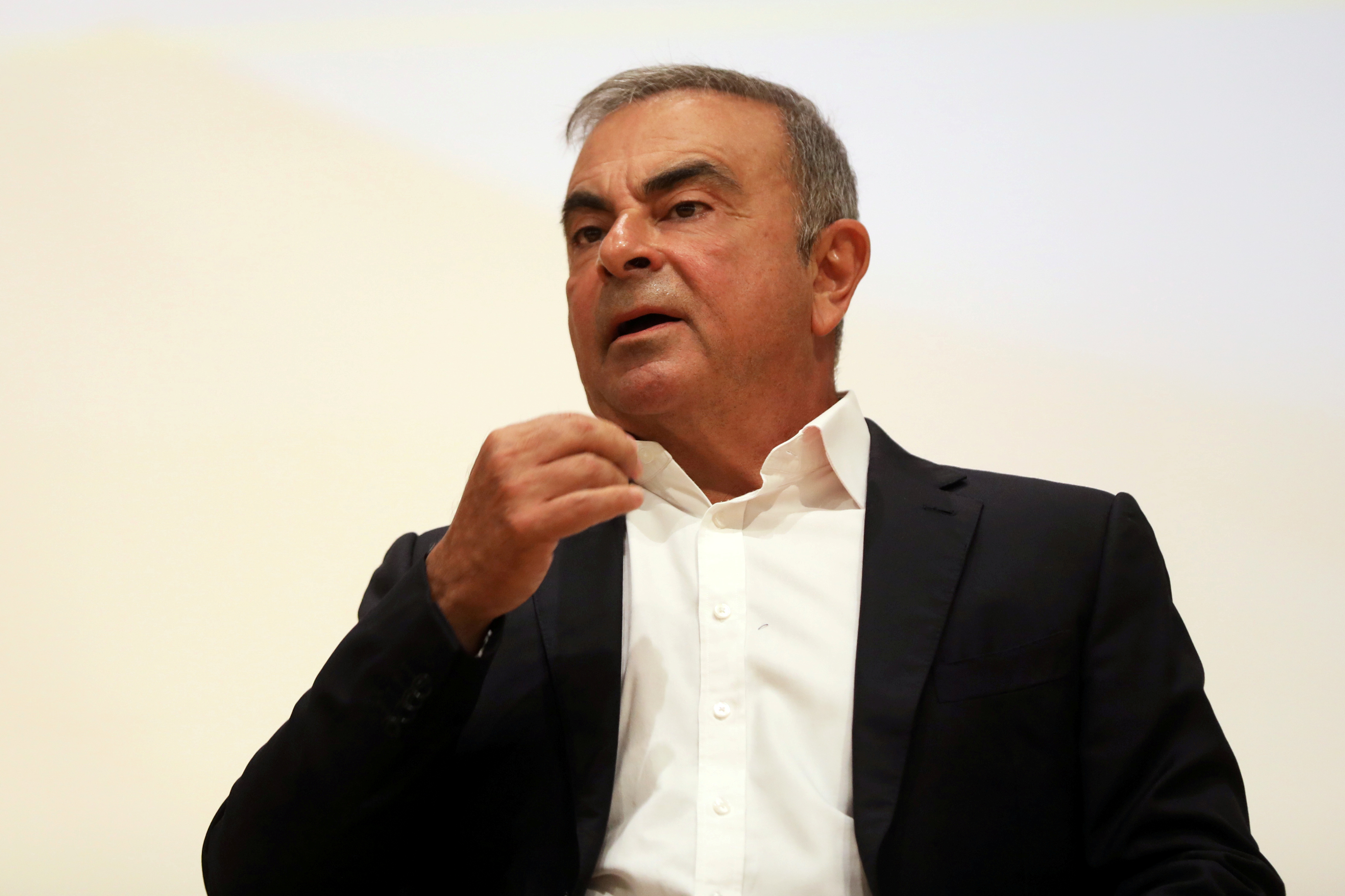 Carlos Ghosn, the former Nissan and Renault chief executive, gestures as he speaks during a news conference at the Holy Spirit University of Kaslik, in Jounieh, Lebanon September 29, 2020. REUTERS/Mohamed Azakir/File Photo