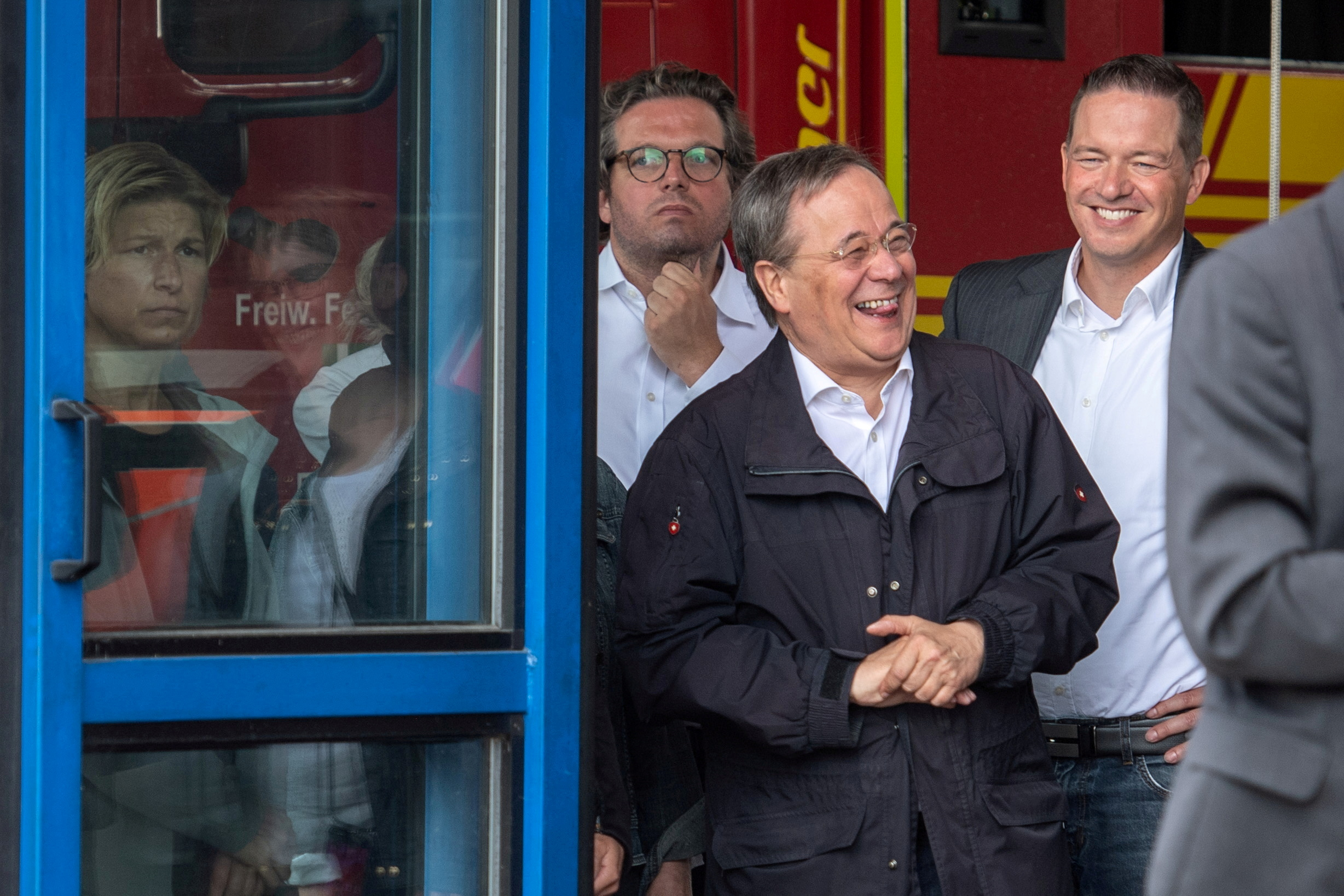 CDU leader and North Rhine-Westphalia's State Premier Armin Laschet laughs as the German president (unseen) delivers a speech during their visit to flood-hit Erftstadt, Germany July 17, 2021. Picture taken July 17, 2021 Marius Becker/Pool/File Photo
