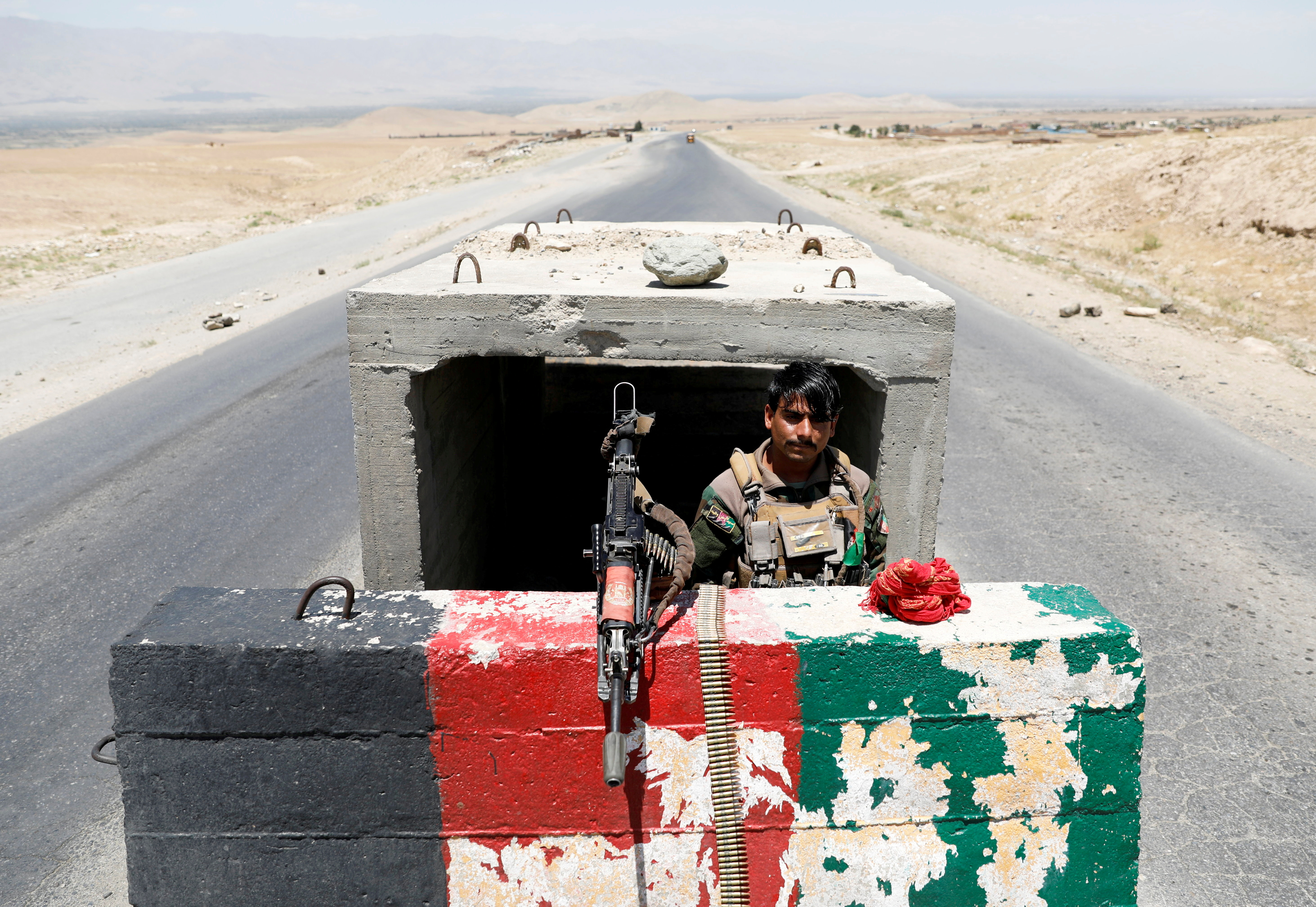 An Afghan National Army soldier stands guard at a checkpoint near Bagram Air Base on the day the last American troops vacated it, in Parwan province, Afghanistan, July 2, 2021. REUTERS/Mohammad Ismail/File Photo