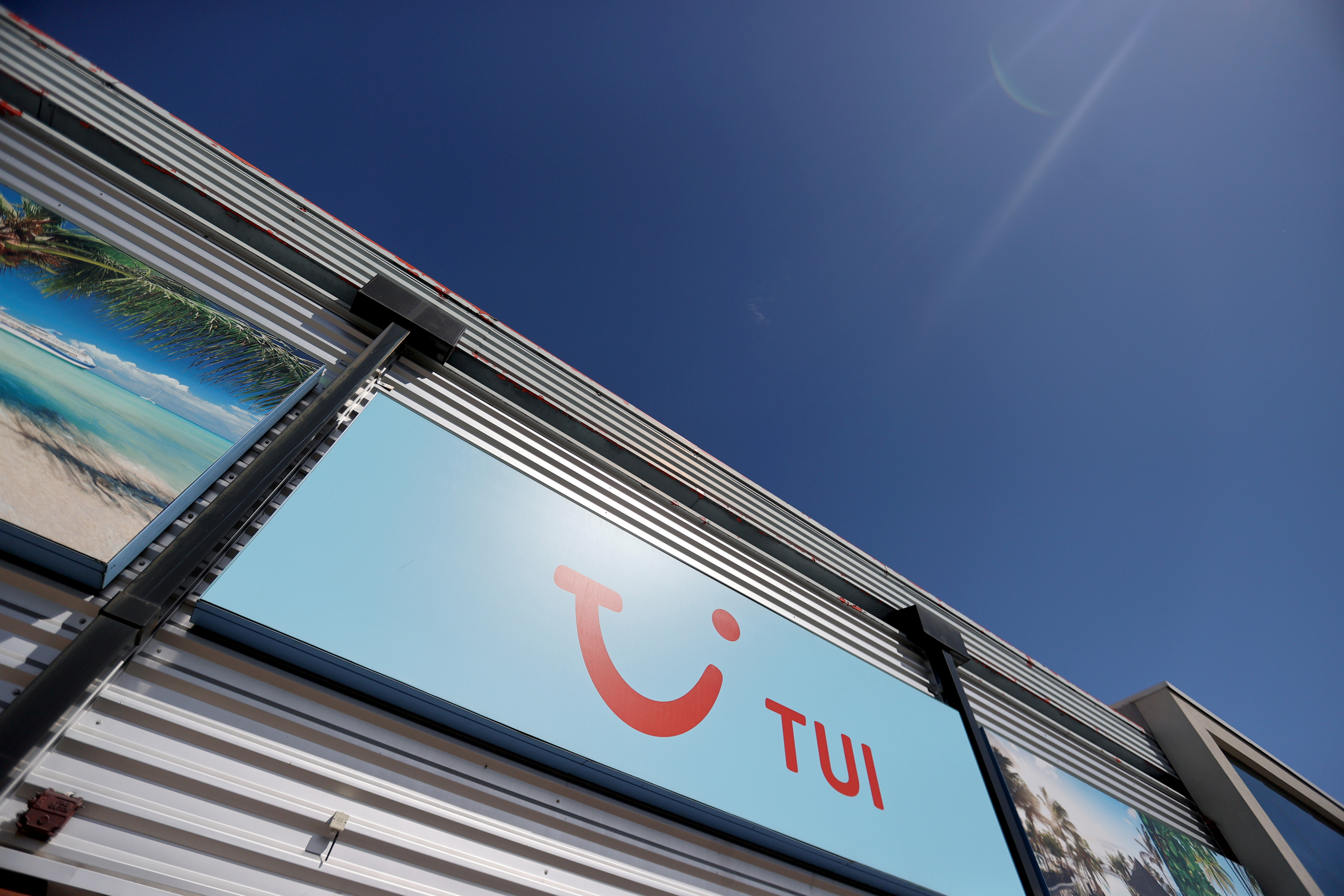 The TUI logo is seen at the TUI travel centre following the coronavirus disease (COVID-19) outbreak, in Hanley, Stoke-on-Trent, Britain, July 28, 2020. REUTERS/Carl Recine