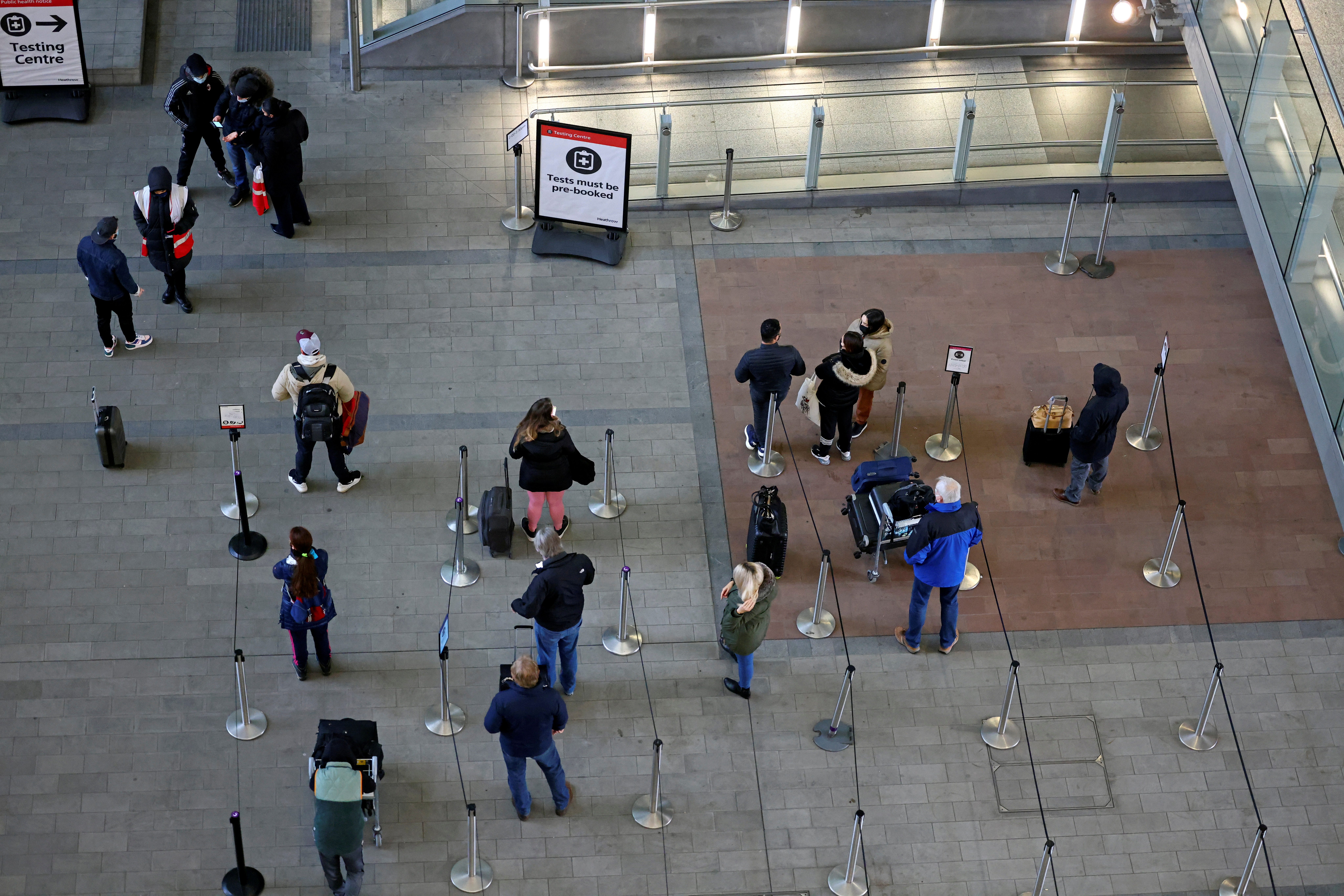 People queue for COVID-19 tests at a testing centre, as tighter rules for international travellers start, at terminal 2 of the Heathrow Airport, amid the spread of the coronavirus disease (COVID-19) pandemic, London, Britain, January 18, 2021. REUTERS/Henry Nicholls