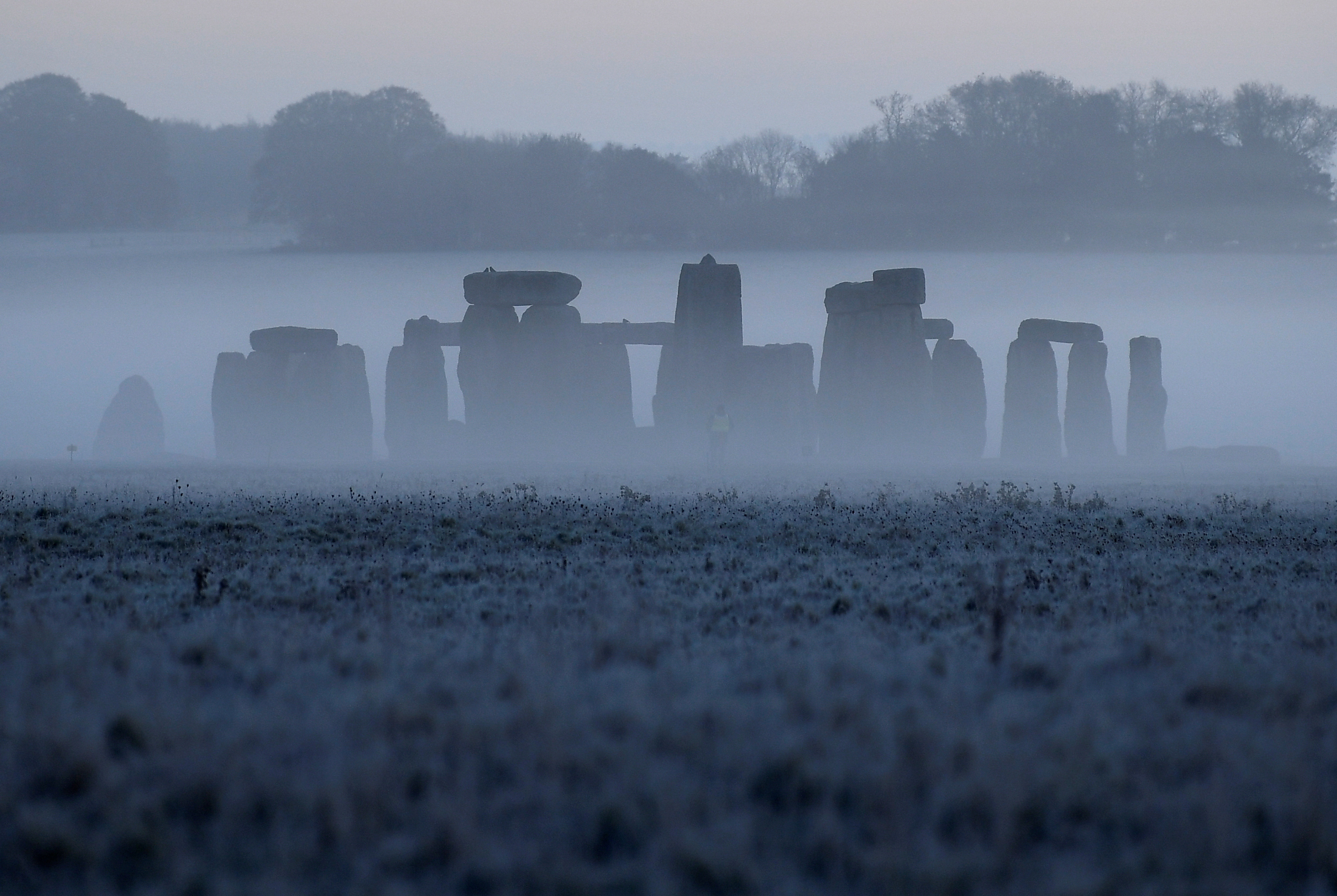 Stonehenge ancient stone circle is seen at dawn, near Amesbury, Wiltshire, Britain, November 4, 2020. REUTERS/Toby Melville/File Photo