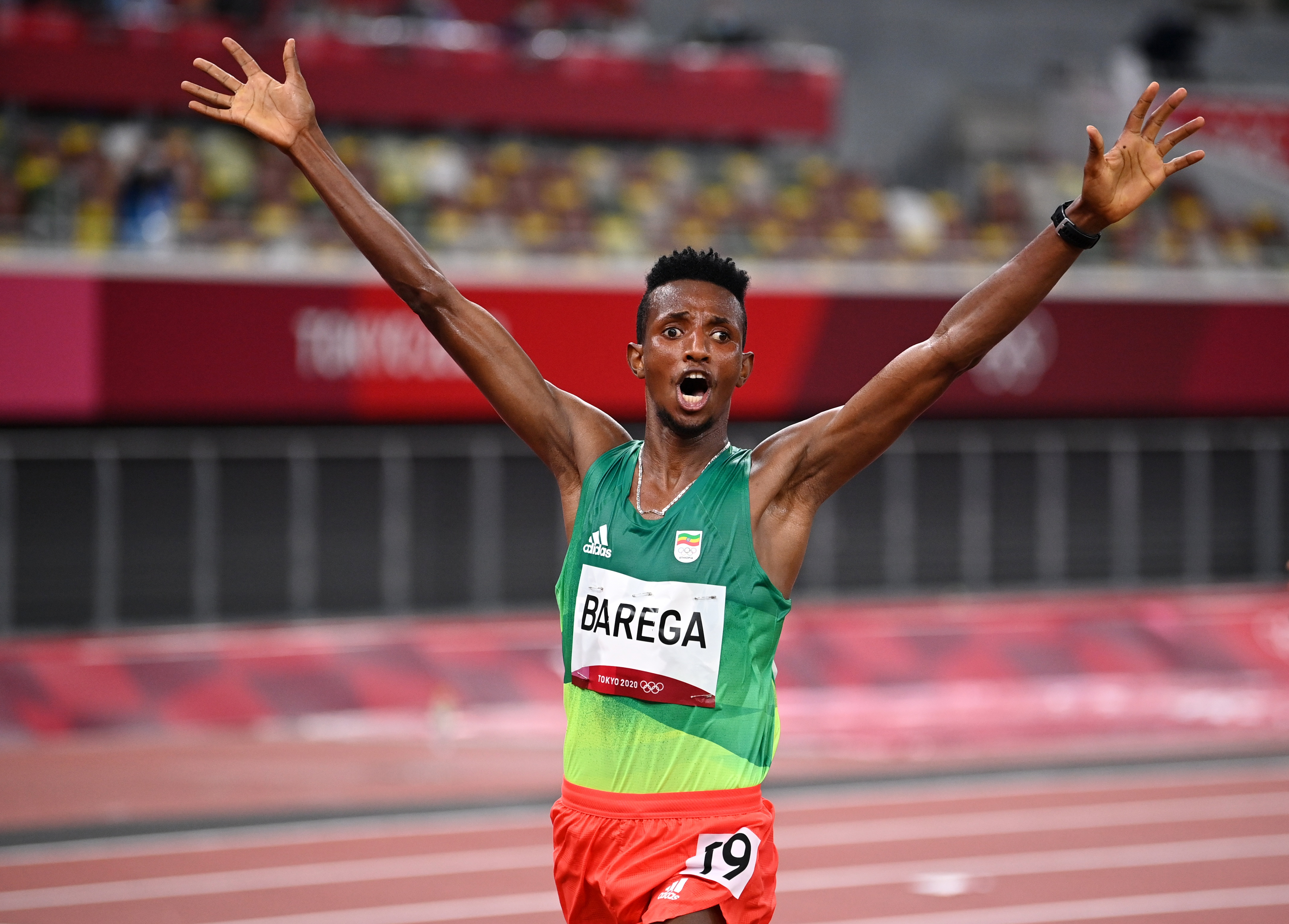 Tokyo 2020 Olympics - Athletics - Men's 10000m - OLS - Olympic Stadium, Tokyo, Japan - July 30, 2021. Selemon Barega of Ethiopia celebrates after winning gold REUTERS/Dylan Martinez
