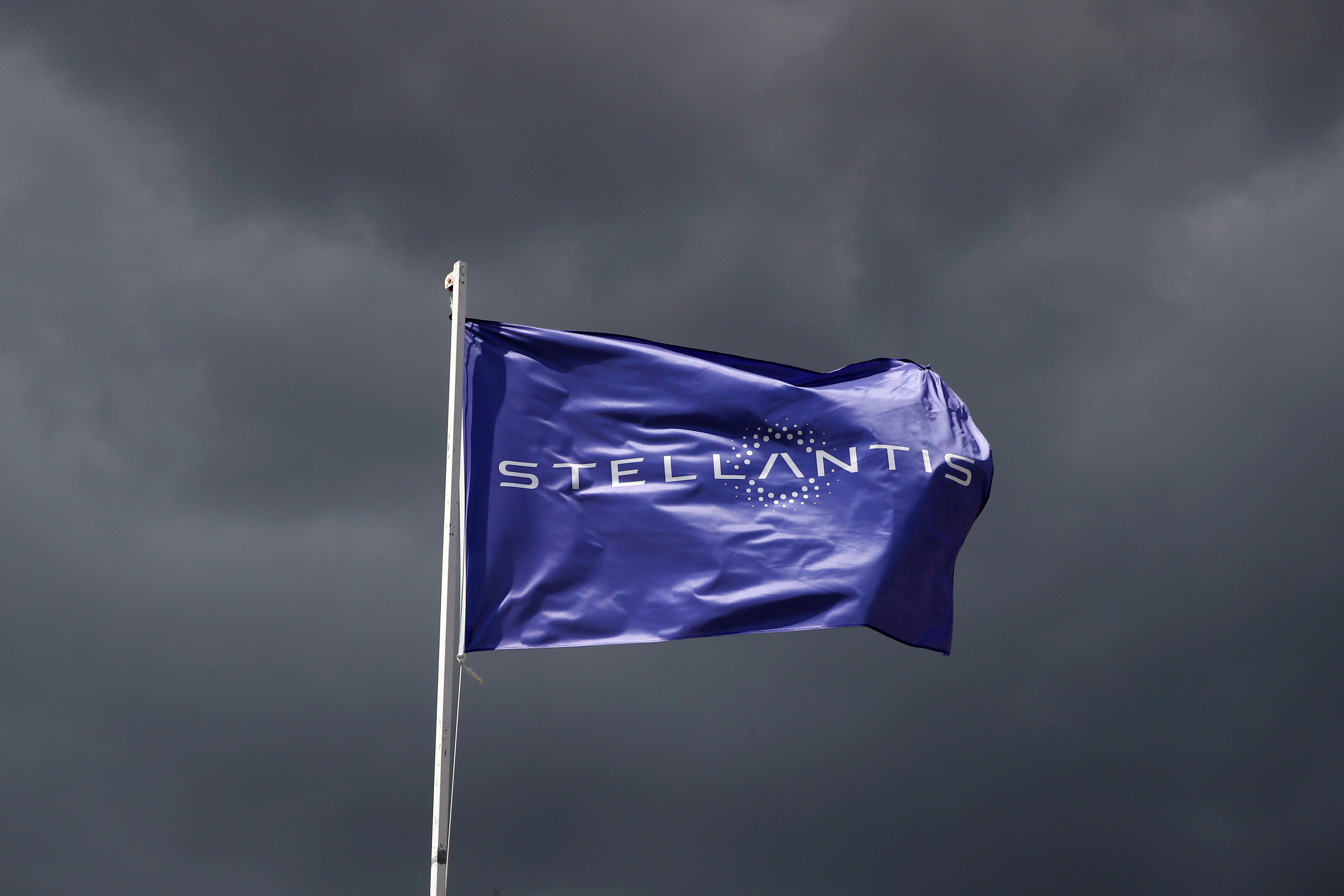A flag with the logo of Stellantis is seen at the company's corporate office building in Saint-Quentin-en-Yvelines near Paris, France, May 5, 2021. REUTERS/Gonzalo Fuentes/File Photo