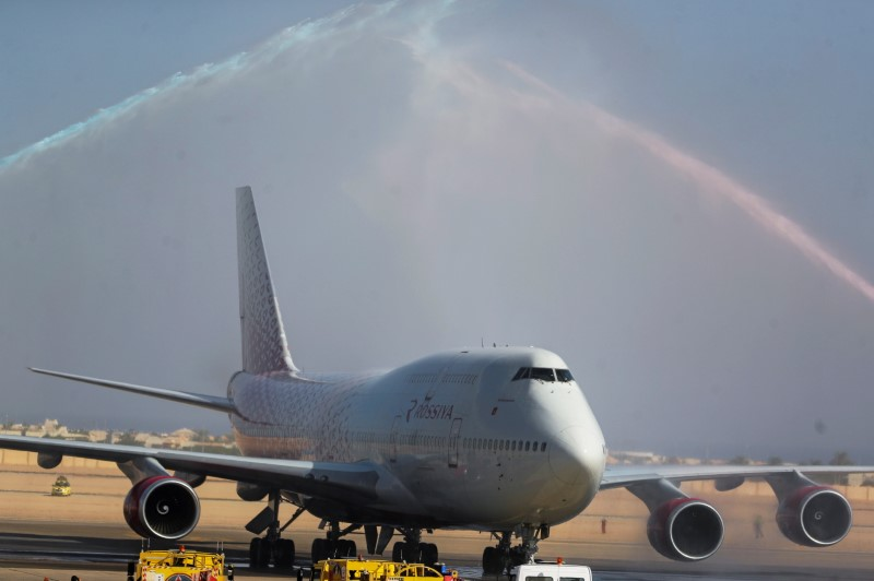 A Rossiya Airlines plane lands to a water cannon salute on the runway of the Sharm El-Sheikh Airport, after a decision to lift an almost six-year ban on direct flights following an airline crash which killed everyone on board in 2015, in the Red Sea resort of Sharm el-Sheikh, Egypt, August 9, 2021. REUTERS/Mohamed Abd El Ghany