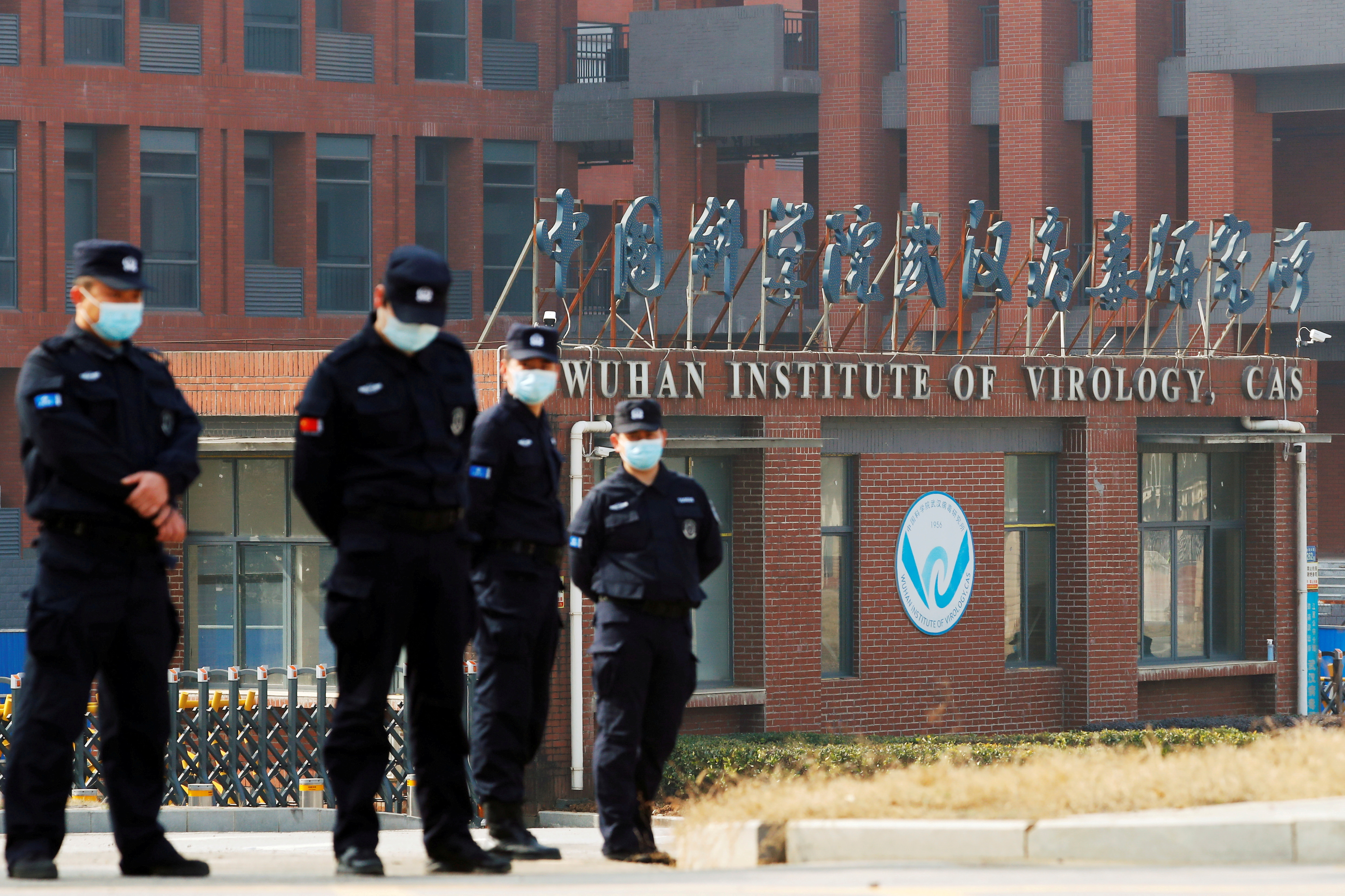 Security personnel keep watch outside Wuhan Institute of Virology during the visit by the World Health Organization (WHO) team tasked with investigating the origins of the coronavirus disease (COVID-19), inWuhan, Hubei province, China February 3, 2021. REUTERS/Thomas Peter/File Photo