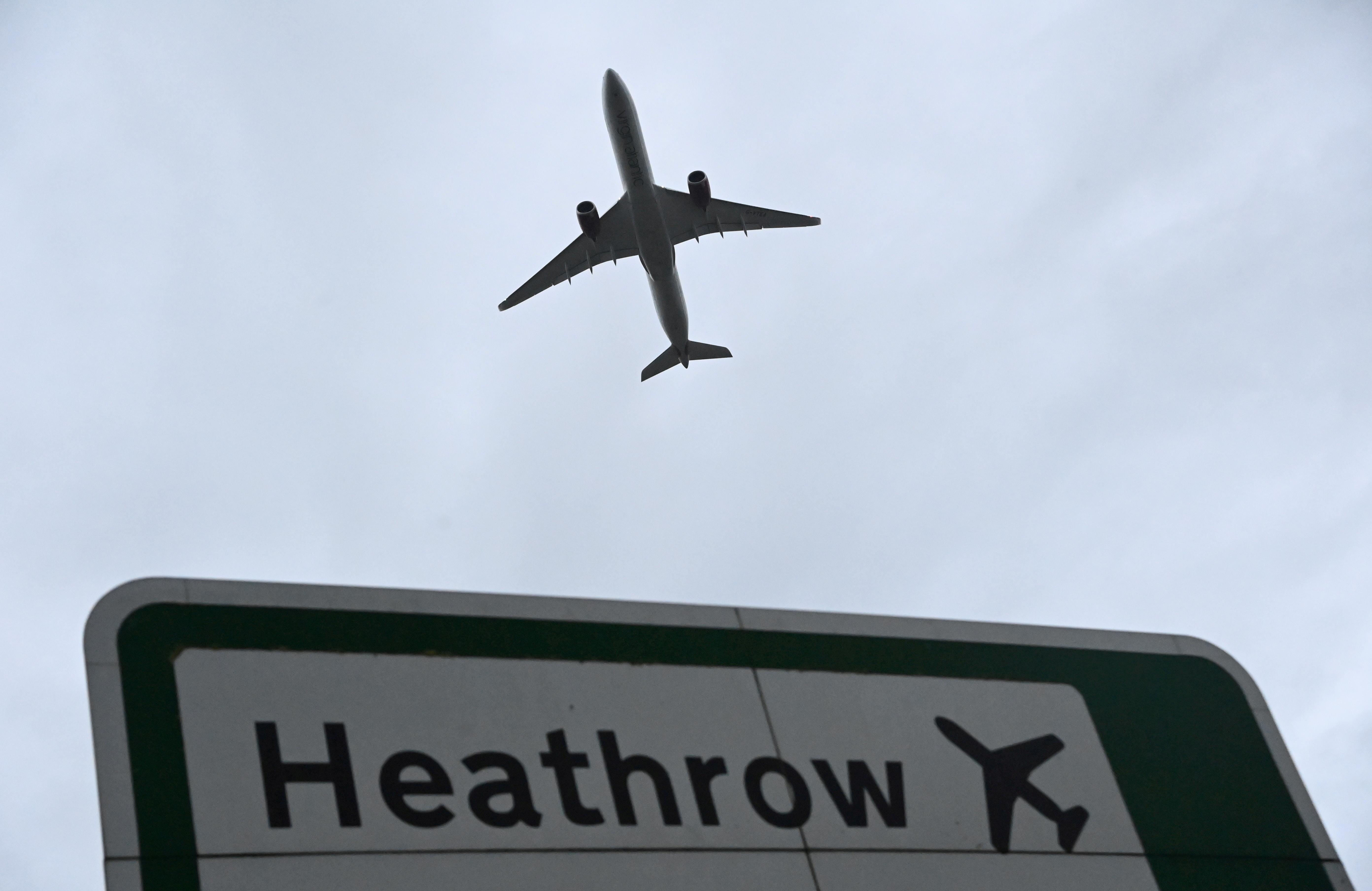 An aircraft takes off at Heathrow Airport amid the spread of the coronavirus disease (COVID-19) pandemic in London, Britain, February 4, 2021. REUTERS/Toby Melville/File Photo