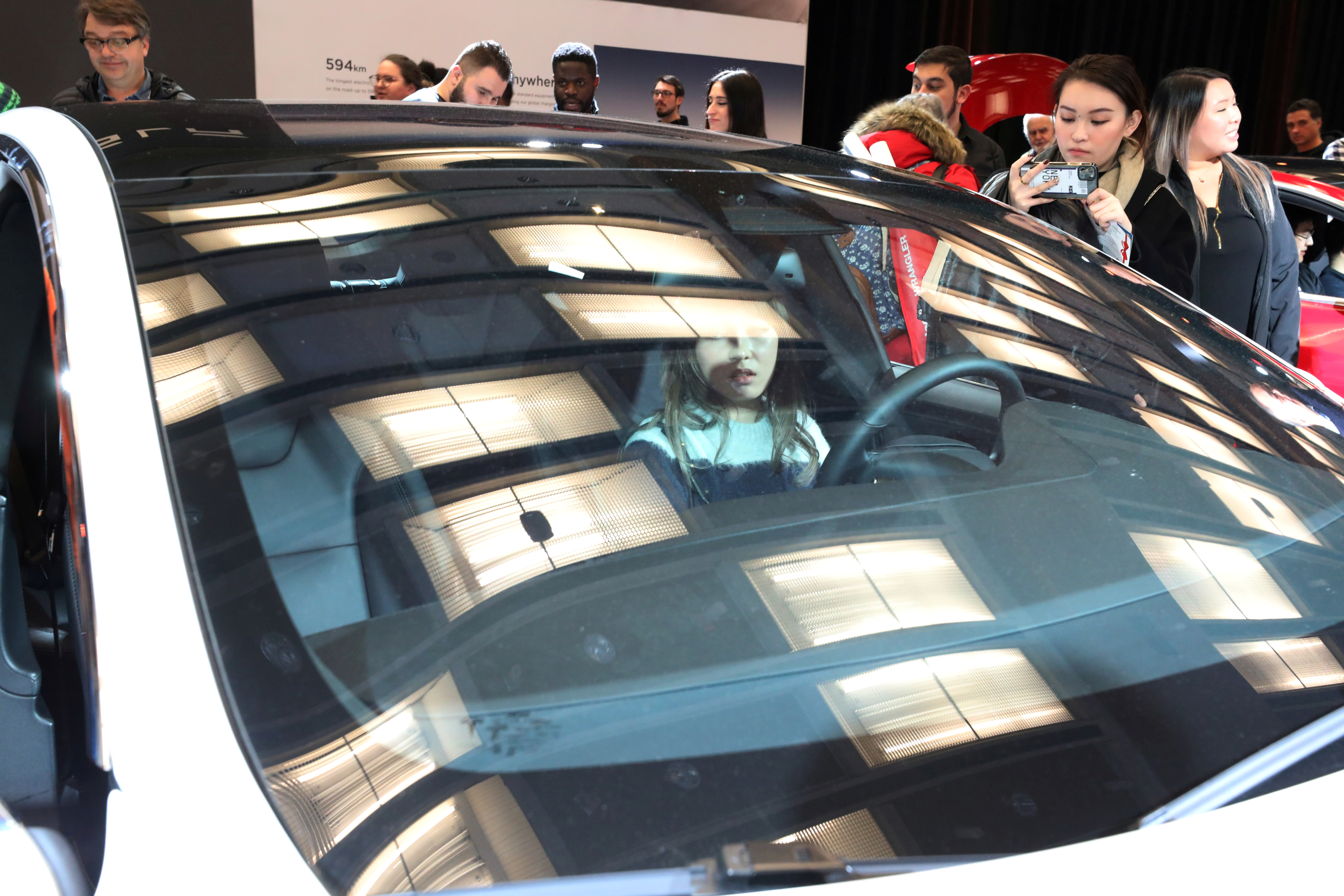 A visitor sits in the Tesla Model S electric vehicle at the Canadian International Auto Show in Toronto, Ontario, Canada February 18, 2020. REUTERS/Chris Helgren/File Photo