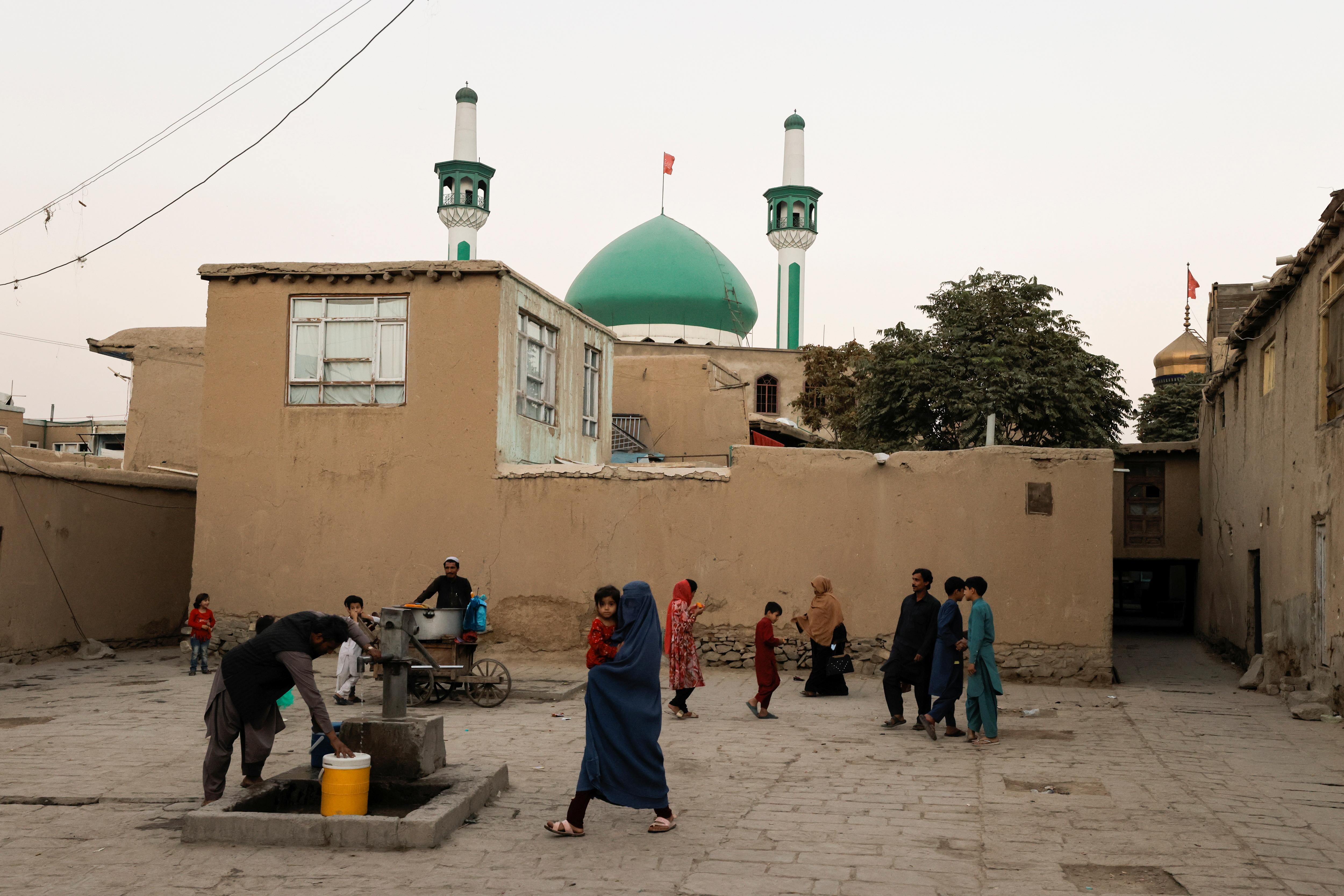 People walks in a square of an old neighborhood of Kabul, Afghanistan October 5, 2021. REUTERS/Jorge Silva